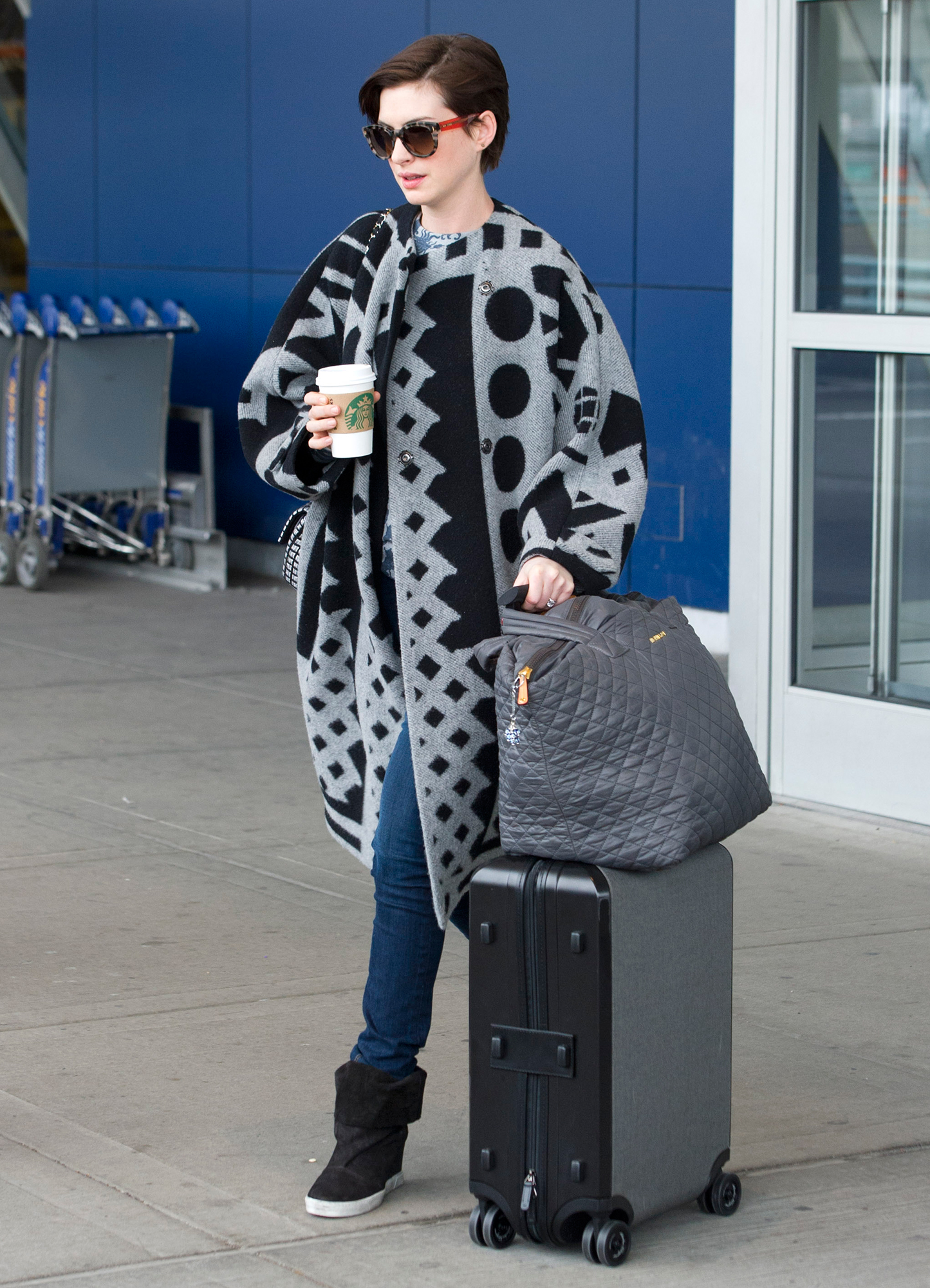Anne Hathaway arrives at JFK airport in NYC