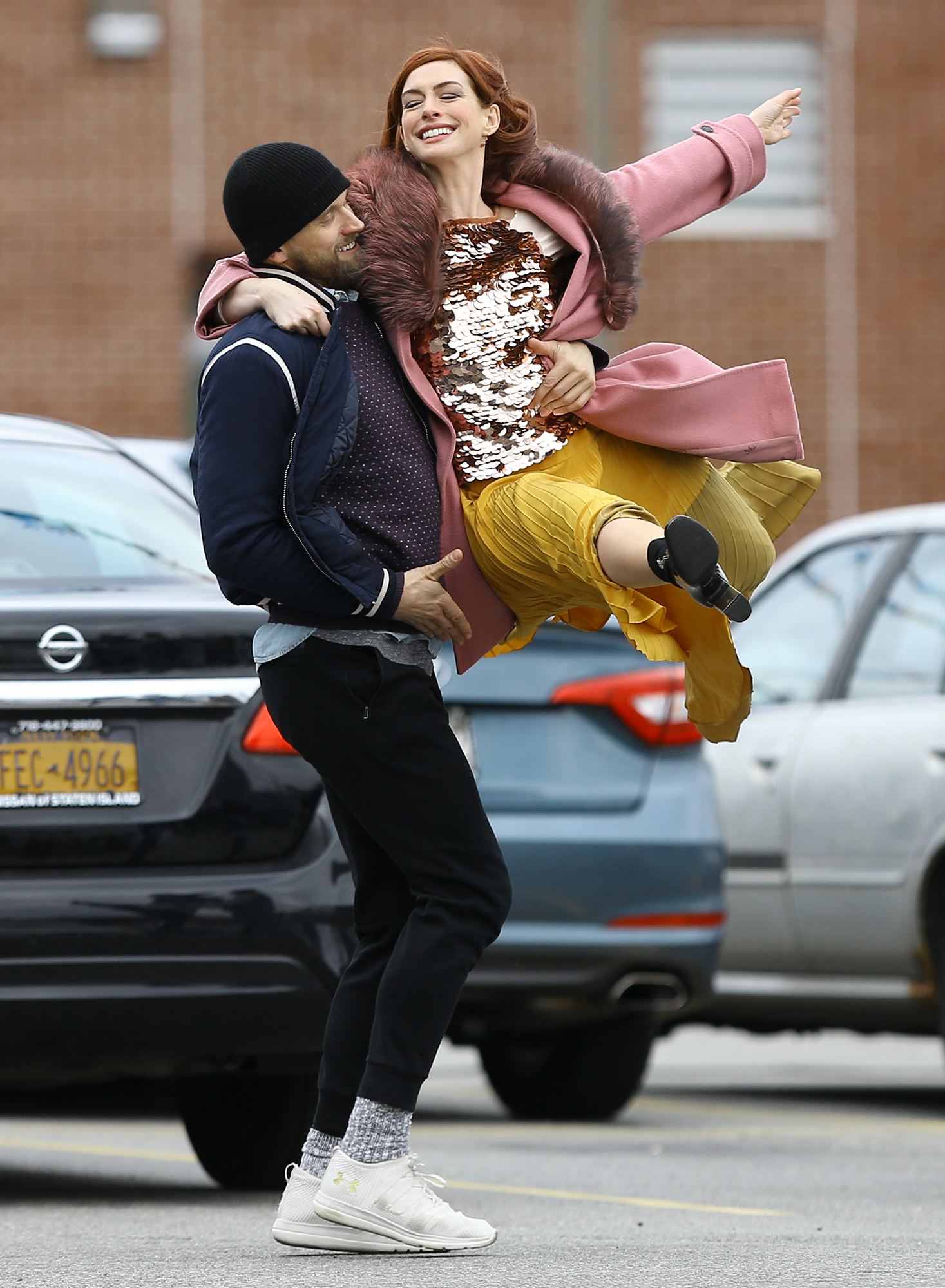 Red-Headed Anne Hathaway Dances In A Parking Lot Filming In Brooklyn