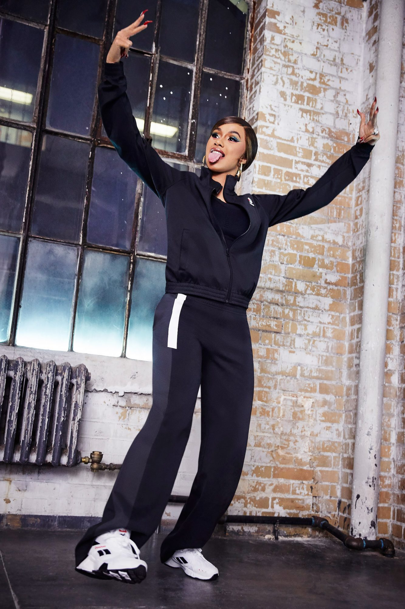 Cardi B has got swagger in a new photoshoot for Reebok Aztrek collaboration