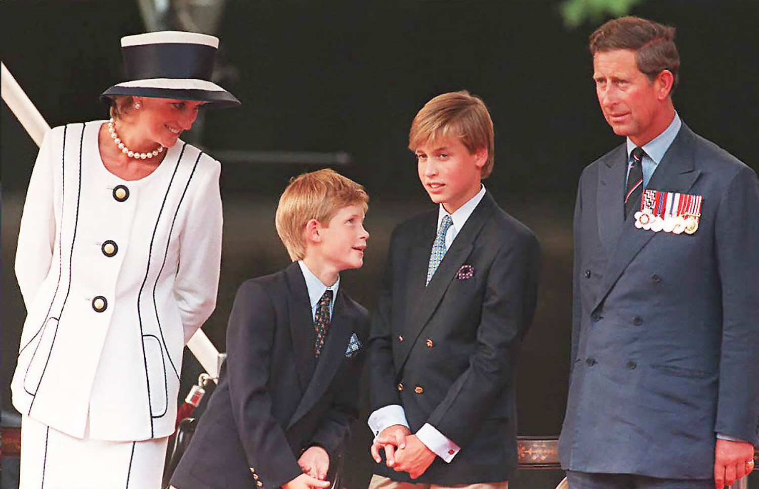 Princess Diana(L), her sons Harry(2nd L)