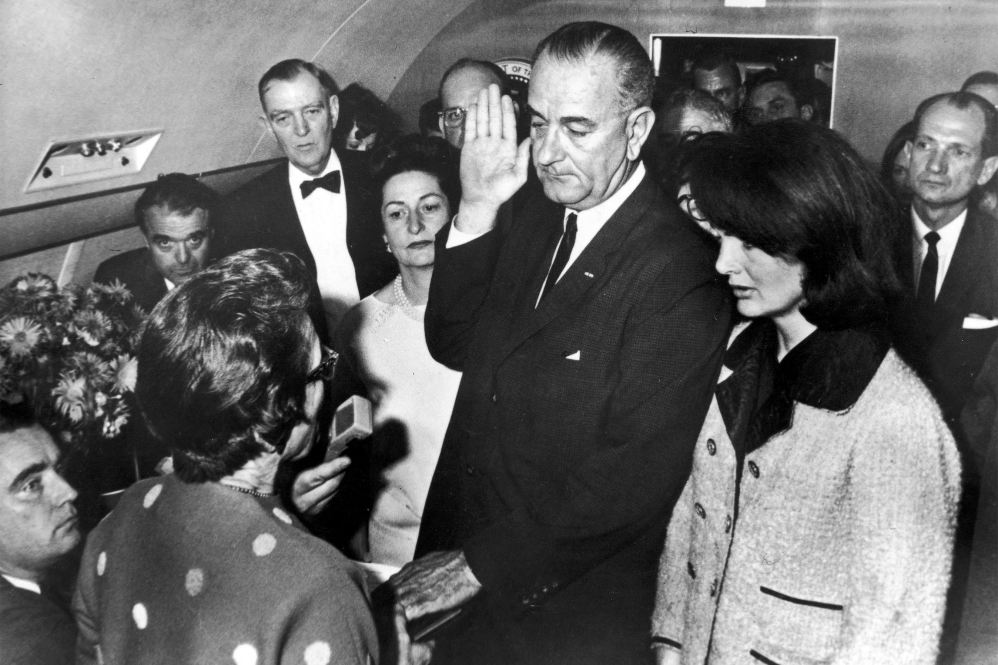 VP Lyndon Johnson (C) taking oath of office fr. Ju