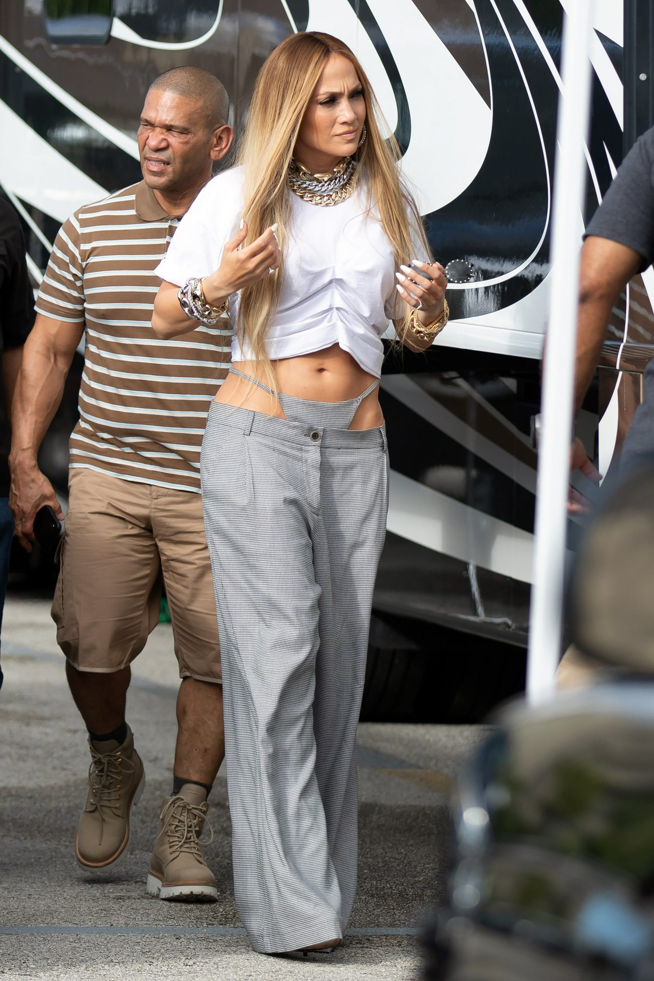 Jennifer Lopez wearing a bizarre sewn on underwear pant look as she arrives to shoot a video with DJ Khaled, Miami.