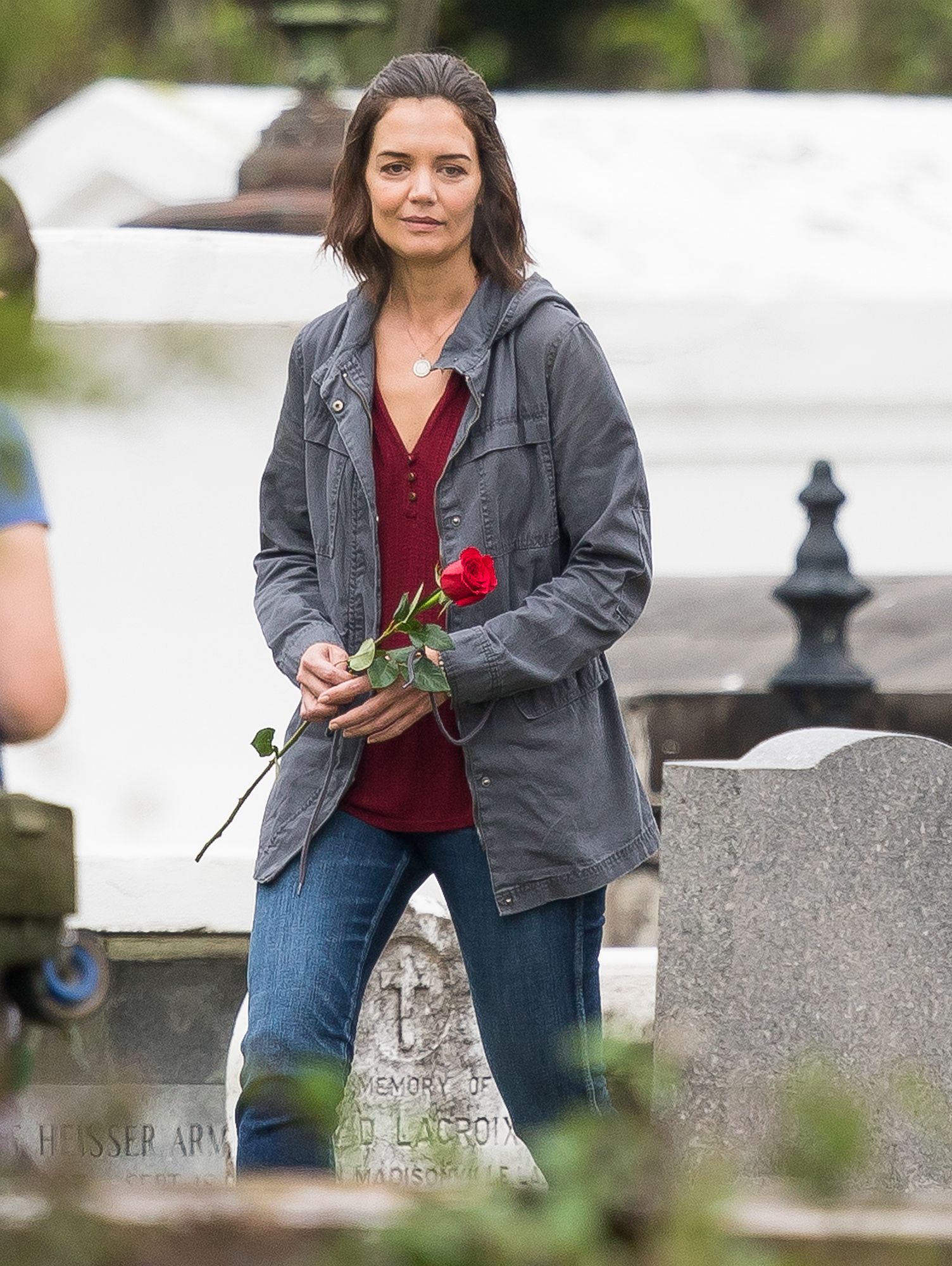EXCLUSIVE: Katie Holmes holding a red rose while filming a graveyard scene on the set of her new movie in New Orleans.