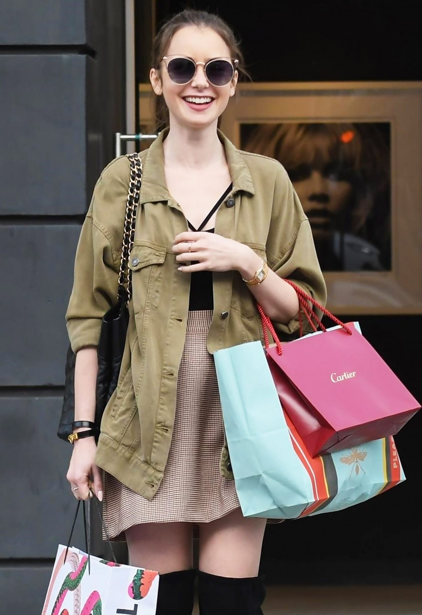 Lily Collins gets an early start on her Christmas shopping at Cartier