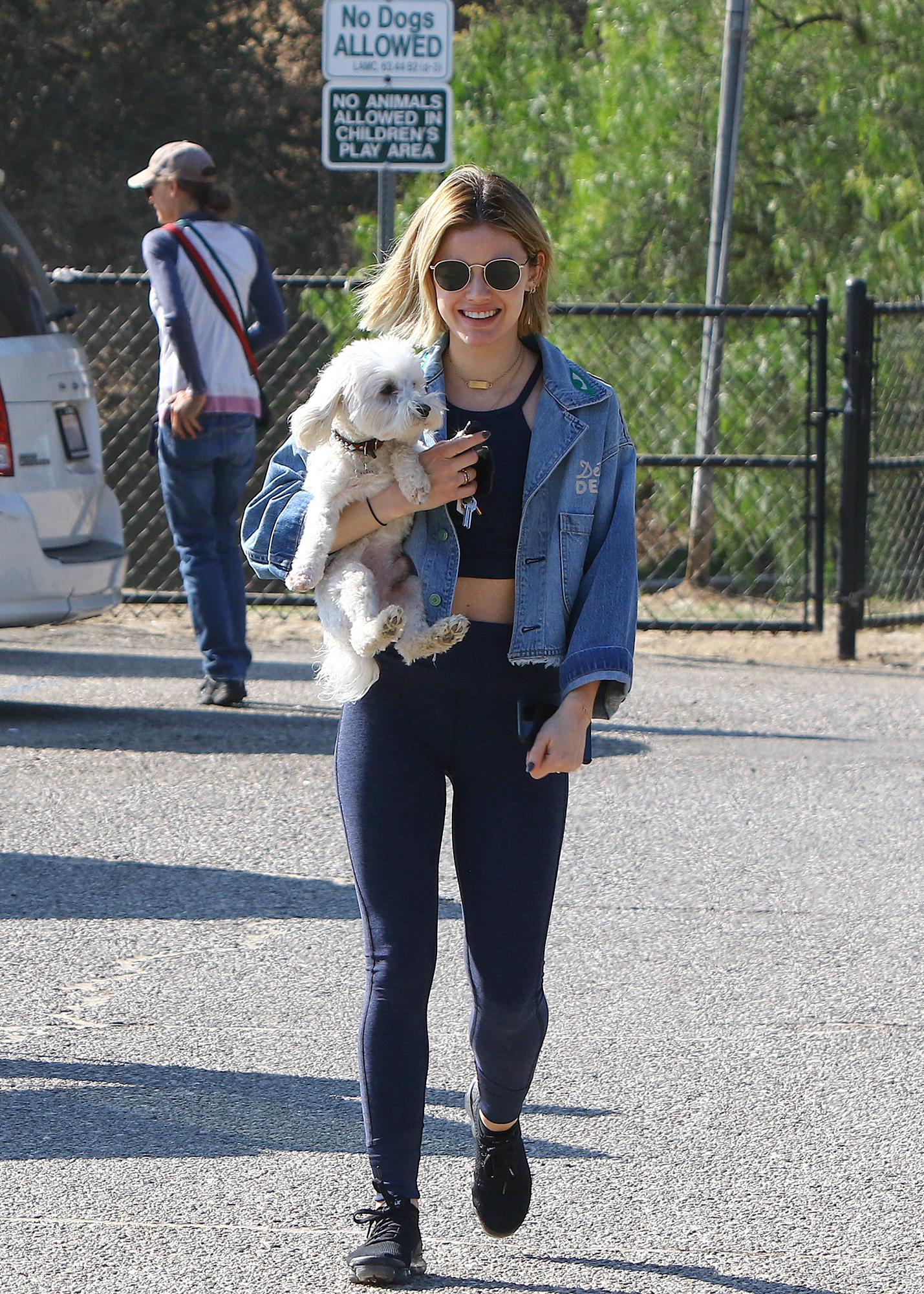 Lucy Hale Carries Her Dog To The Dog Park In Los Angeles