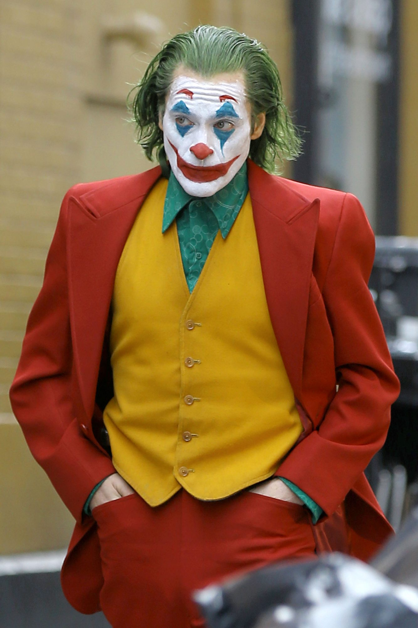 Actor Joaquin Phoenix, dressed as The Joker, sprints down the street and enters the subway filming ?The Joker? in the Bronx in New York City, New York on November 18,2018.