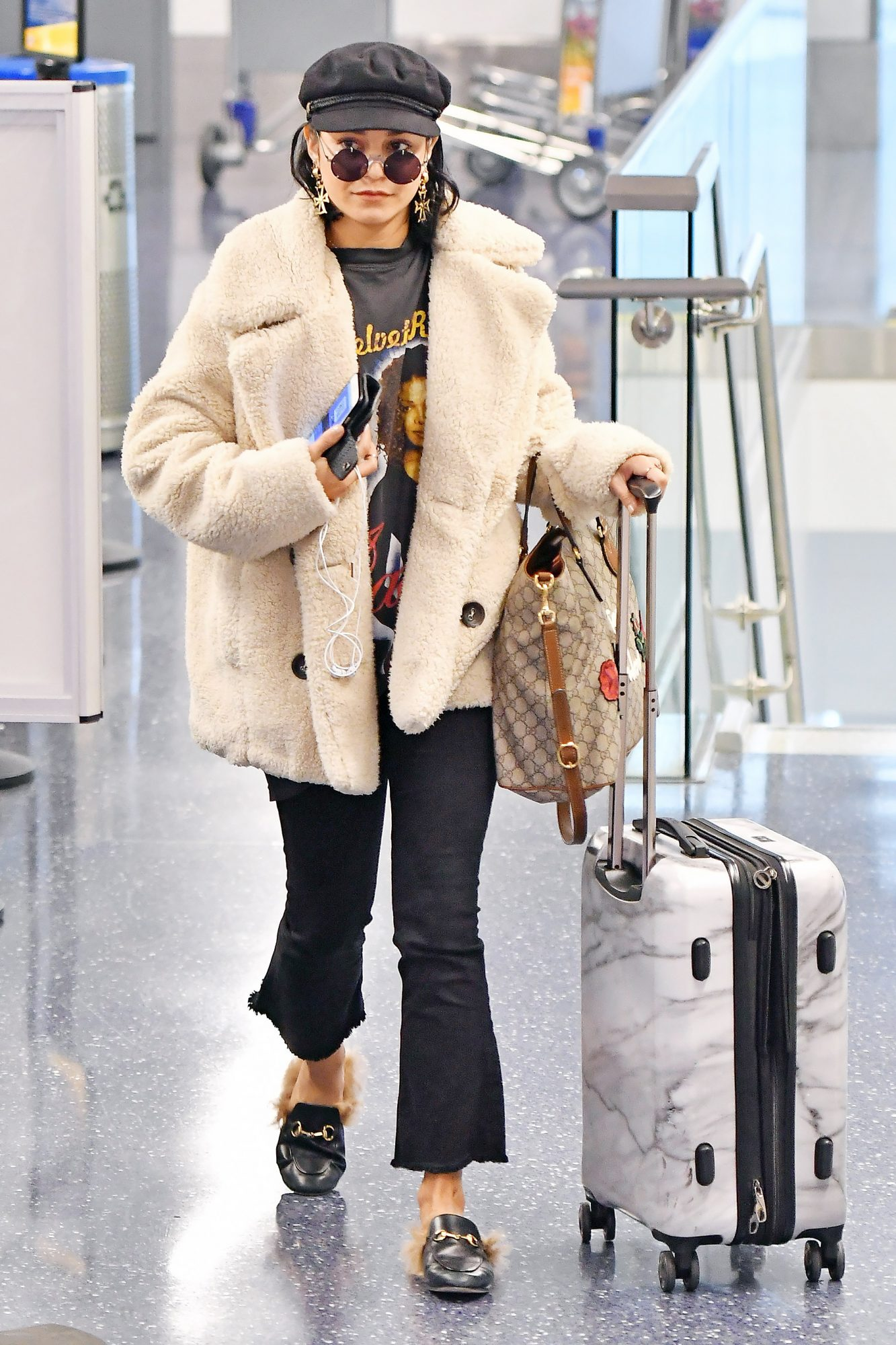 EXCLUSIVE: Vanessa Hudgens arrives at LAX in a fur coat and a vintage Janet Jackson T Shirt