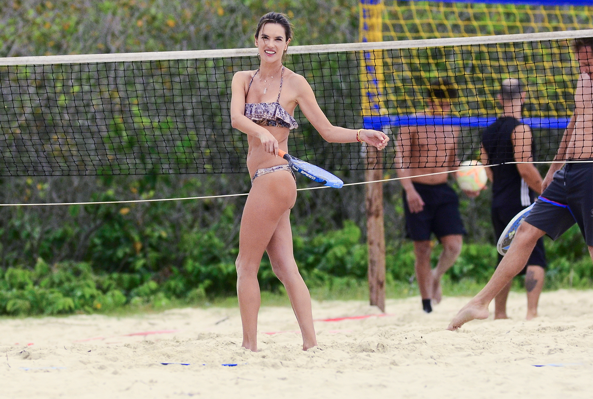 EXCLUSIVE: Super Model Alessandra Ambrosio displays her amazing figure in a two piece bikini on the beach as she is seen engaged in a match of Beach Tennis while on Holiday in Brazil.