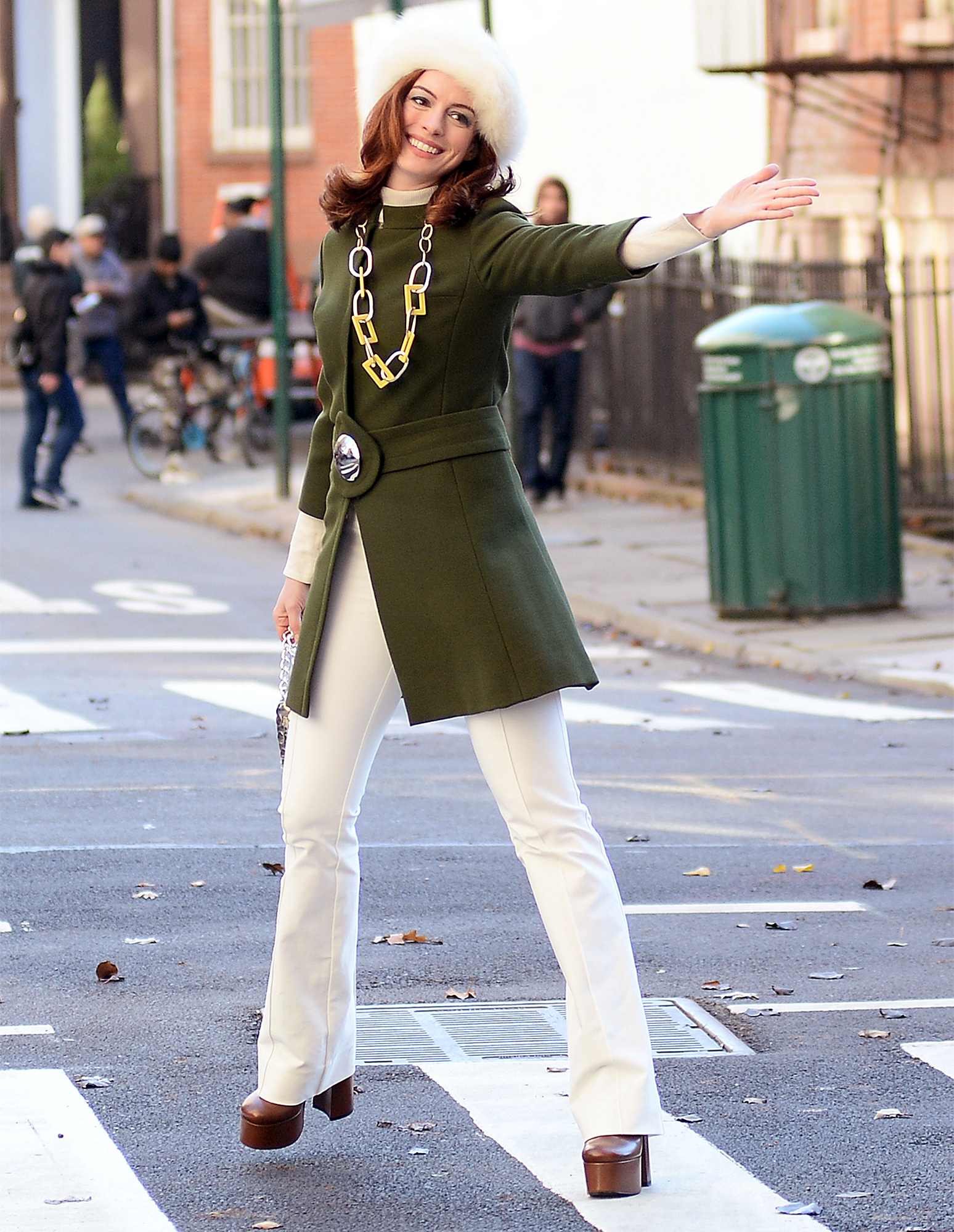 Anne Hathaway got her Jackie-O look-a-like moment trowing kisses and smiling while filming Modern Love series in new york City