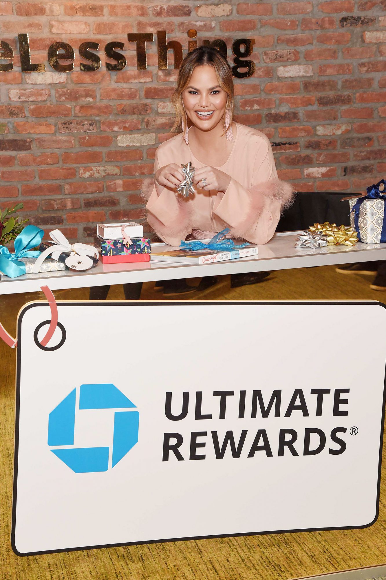 Chrissy Teigen Using Chase Ultimate Rewards at the #OneLessThing Holiday Pop-Up Shop