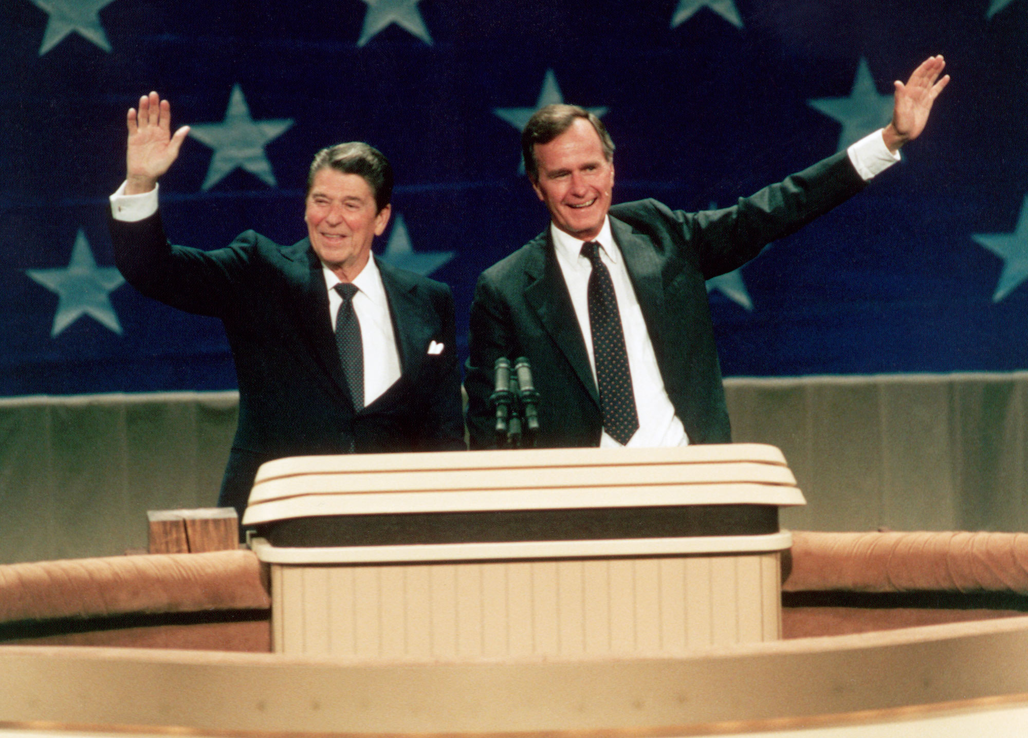 Ronald Reagan and George Bush, the Republican nominees for president and vice president, waving from the podium at the Republican National Convention in 1984. (Photo by © CORBIS/Corbis via Getty Images)