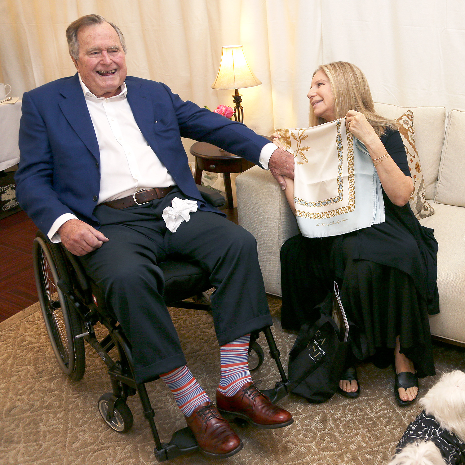 "HOUSTON, TX - NOVEMBER 27: Former President George H.W. Bush and Barbra Streisand speak backstage during the ""Barbra - The Music... The Mem'ries... The Magic! Tour"" at Toyota Center on November 27, 2016 in Houston, Texas. (Photo by Bob Levey/WireImage)"