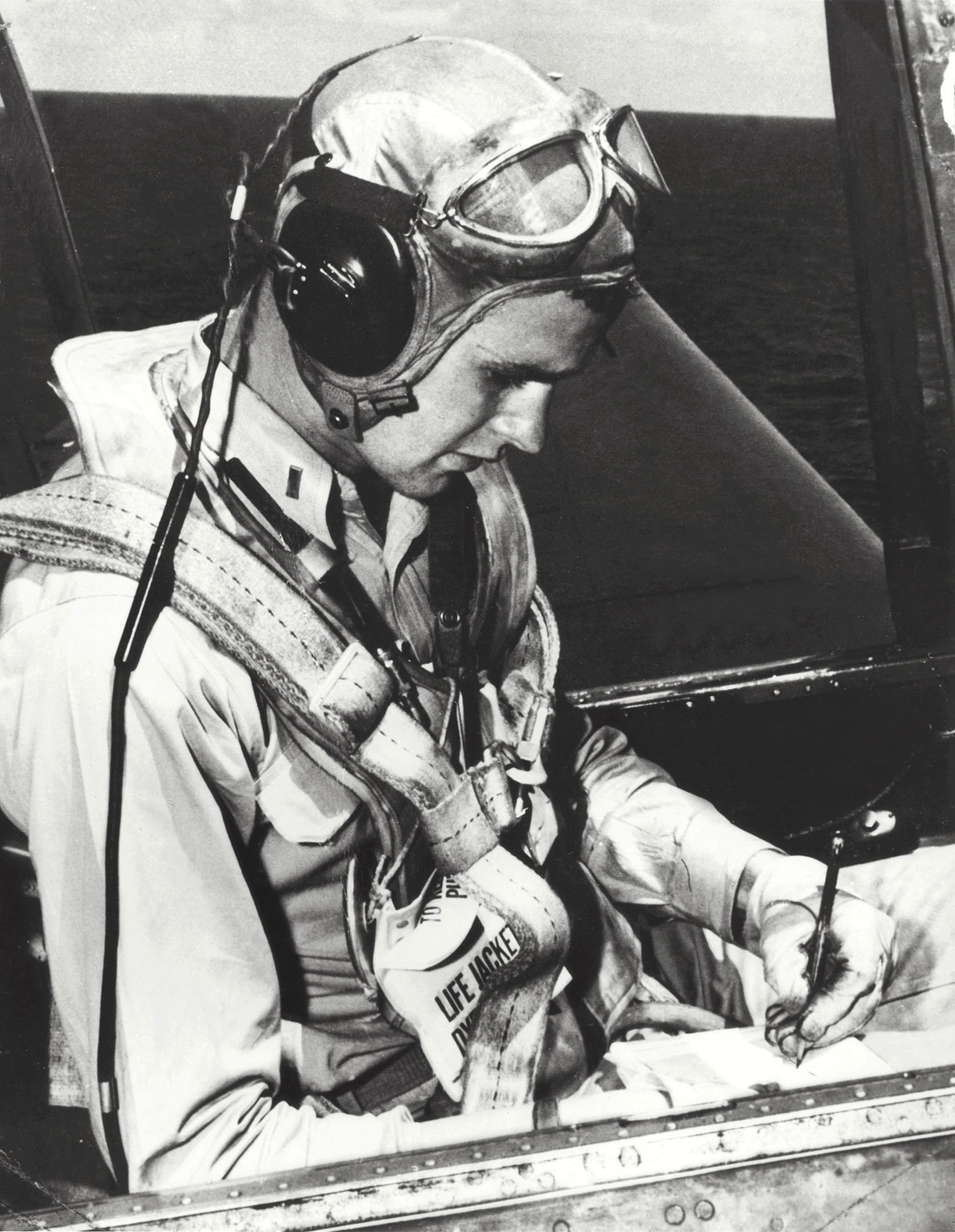 George Herbert Walker Bush is pictured in the cockpit of his TBM Avenger during the World War II. Born 12 June 1924 in Milton, Massachussetts, George Bush Yale graduated with a degree in Economics in 1948, made a fortune drilling oil before entering politics in 1964. US Congressman from Texas (1966-1970), ambassador to the United nations (1971-1974), Special Envoy to China (1974-1975), Republican National Chairman (1975-1976), Central Intelligence Agency (CIA) director (1976-1977), vice president of the US (1981-1959) George Bush is eventually elected president of the US 08 November 1988 against Democratic nominee Michael Dukakis. AFP PHOTO/WHITE HOUSE (Photo credit should read /AFP/Getty Images)