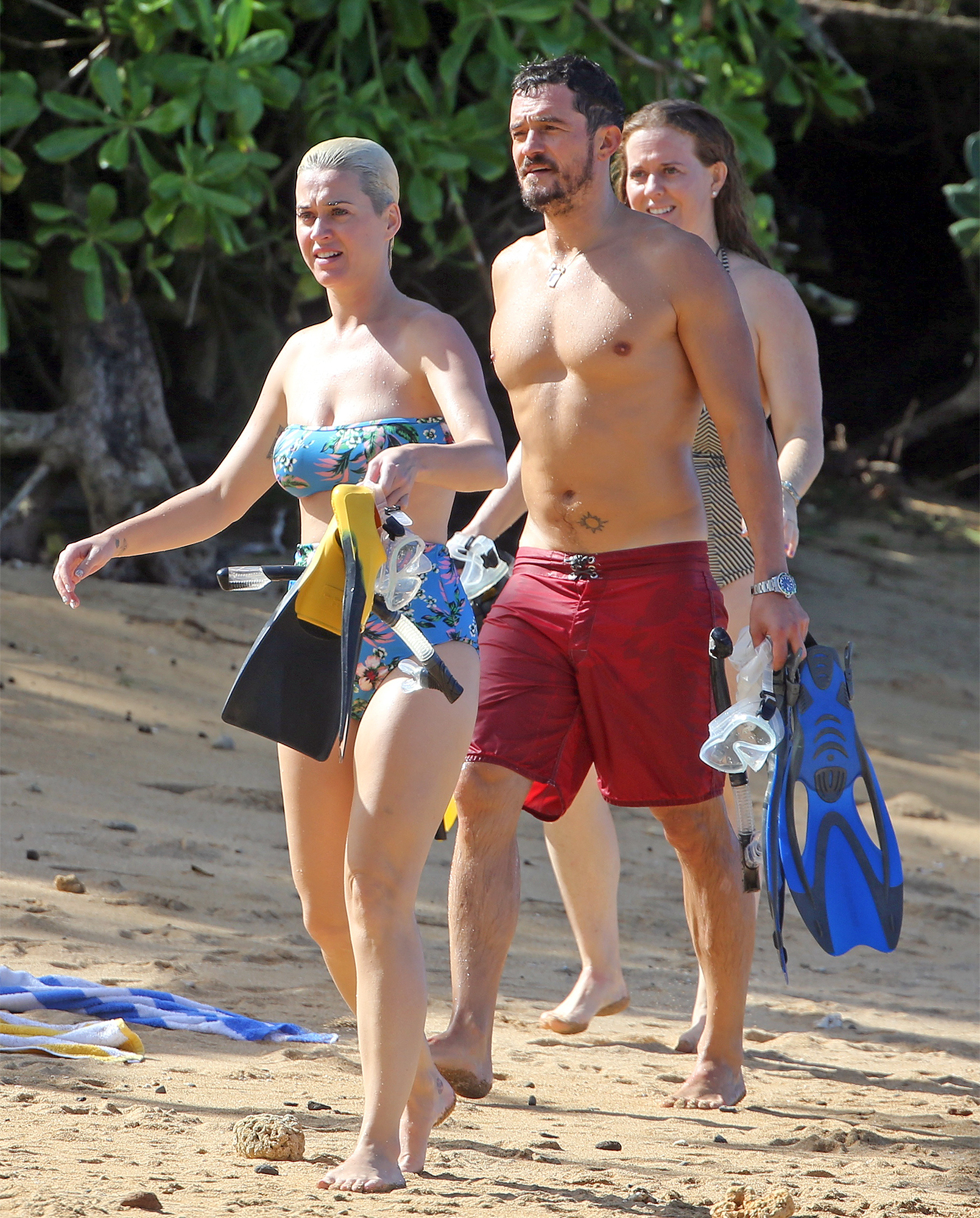 EXCLUSIVE: Orlando Bloom and Katy Perry spend their Christmas vacation on the beach in Hawaii with family