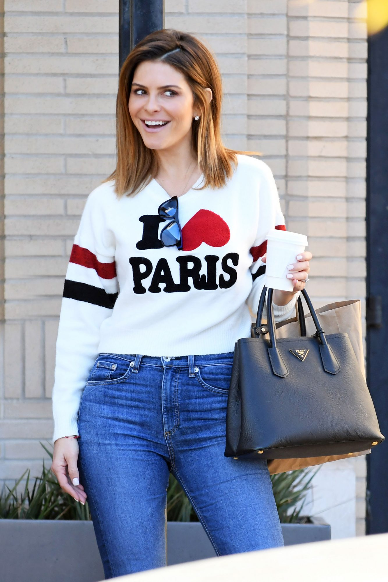 """Maria Menounos shops at Barney's New York in an """"I Love Paris"""" sweater in Beverly Hills"""