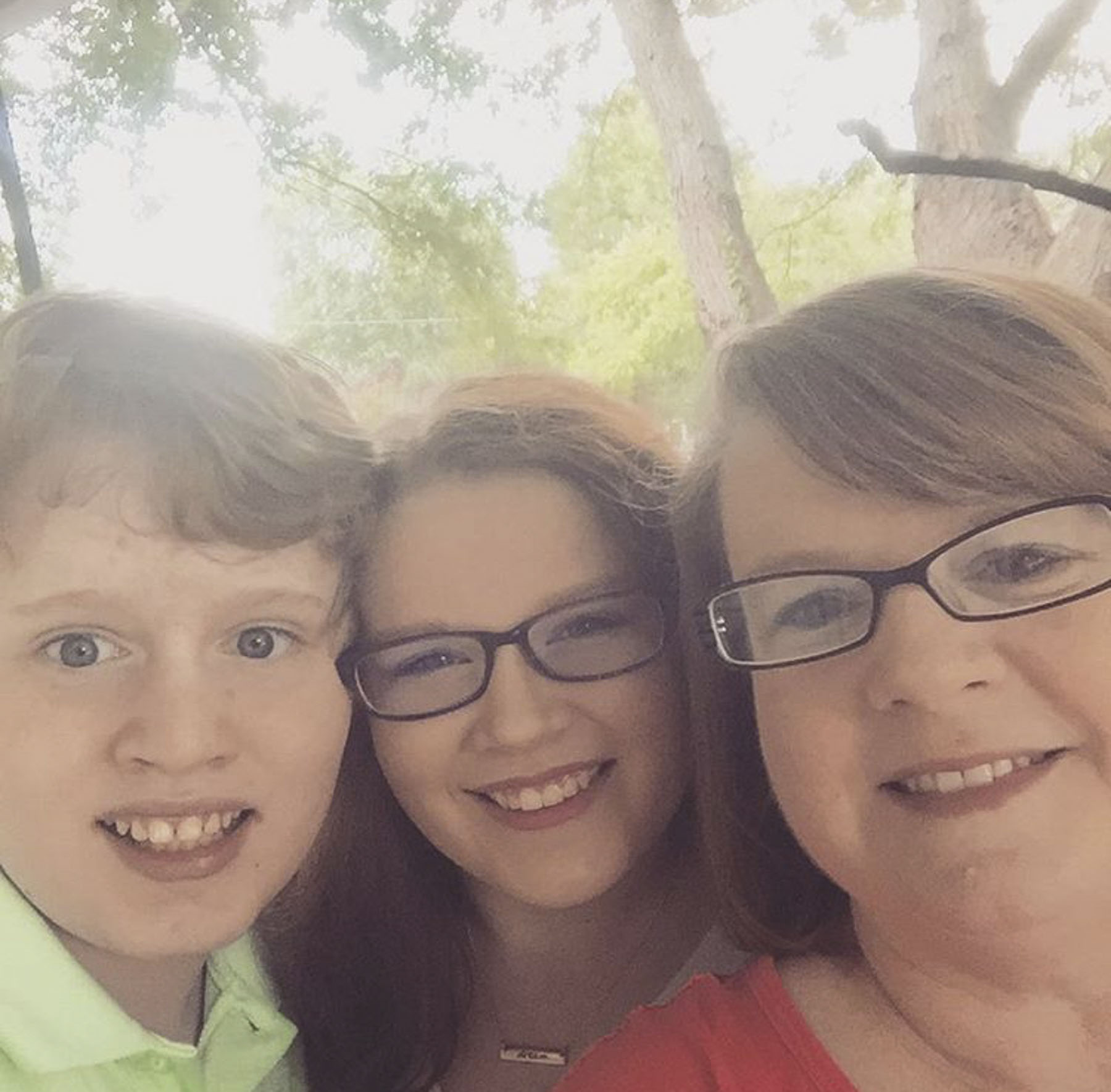 Julie Barr, with son Adam, 14, and daughter Lydia, 20_Courtesy of Julie Barr.jpeg