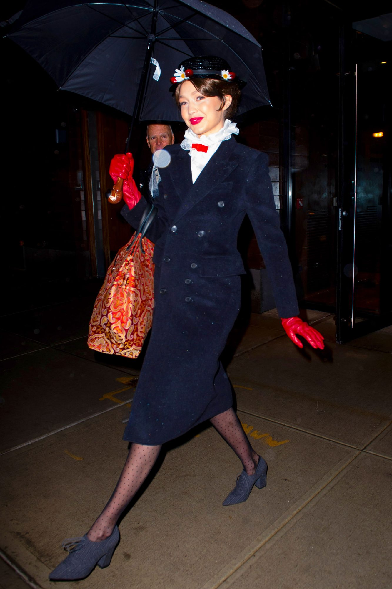 EXCLUSIVE: Gigi Hadid is Dressed as Mary Poppins as she Heads to a New Years Eve Party at Taylor Swift's Apartment in New York City.