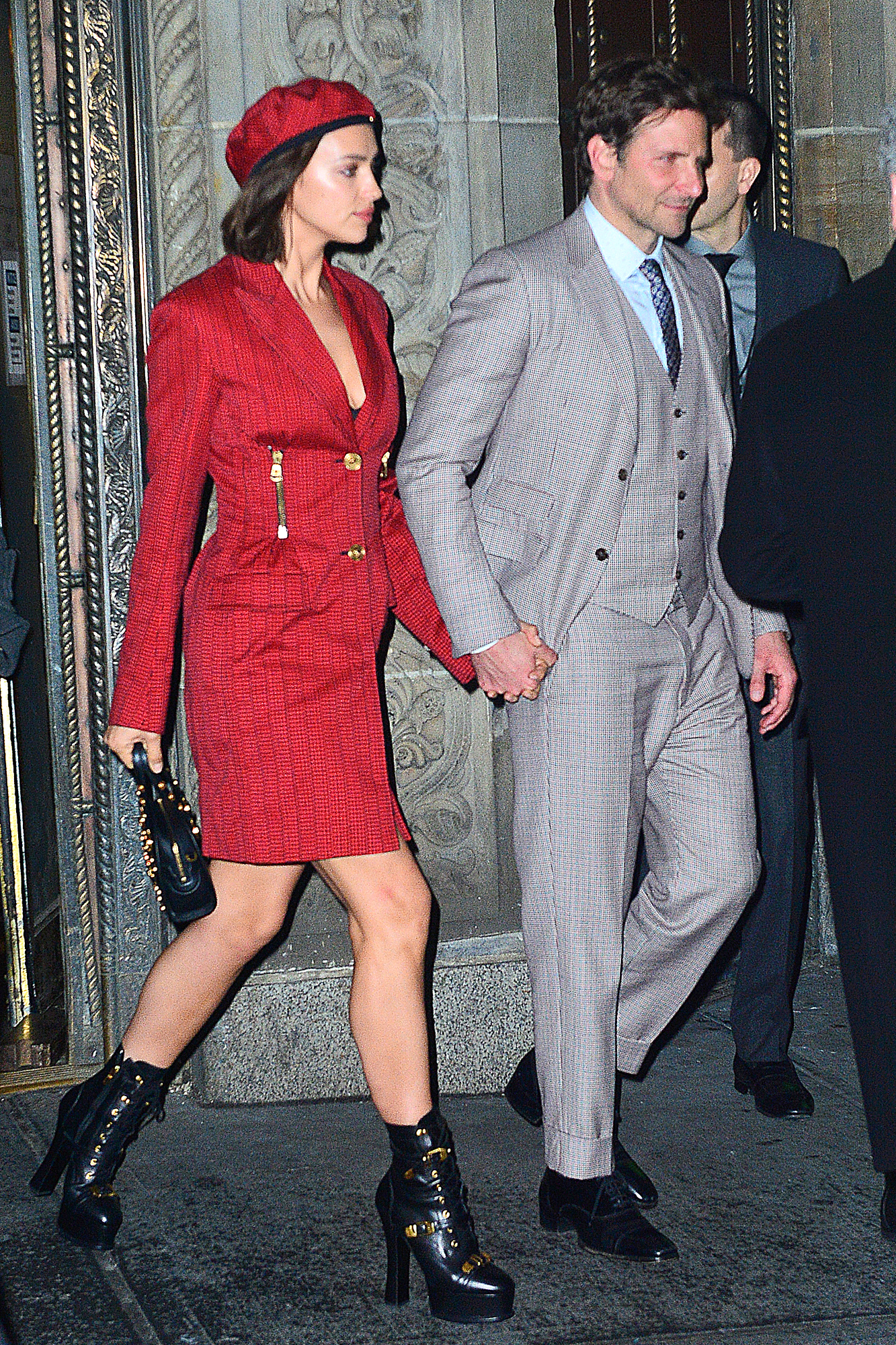 Bradley Cooper and Irina Shayk hold hands as they leave the National Board of Review Awards in NYC