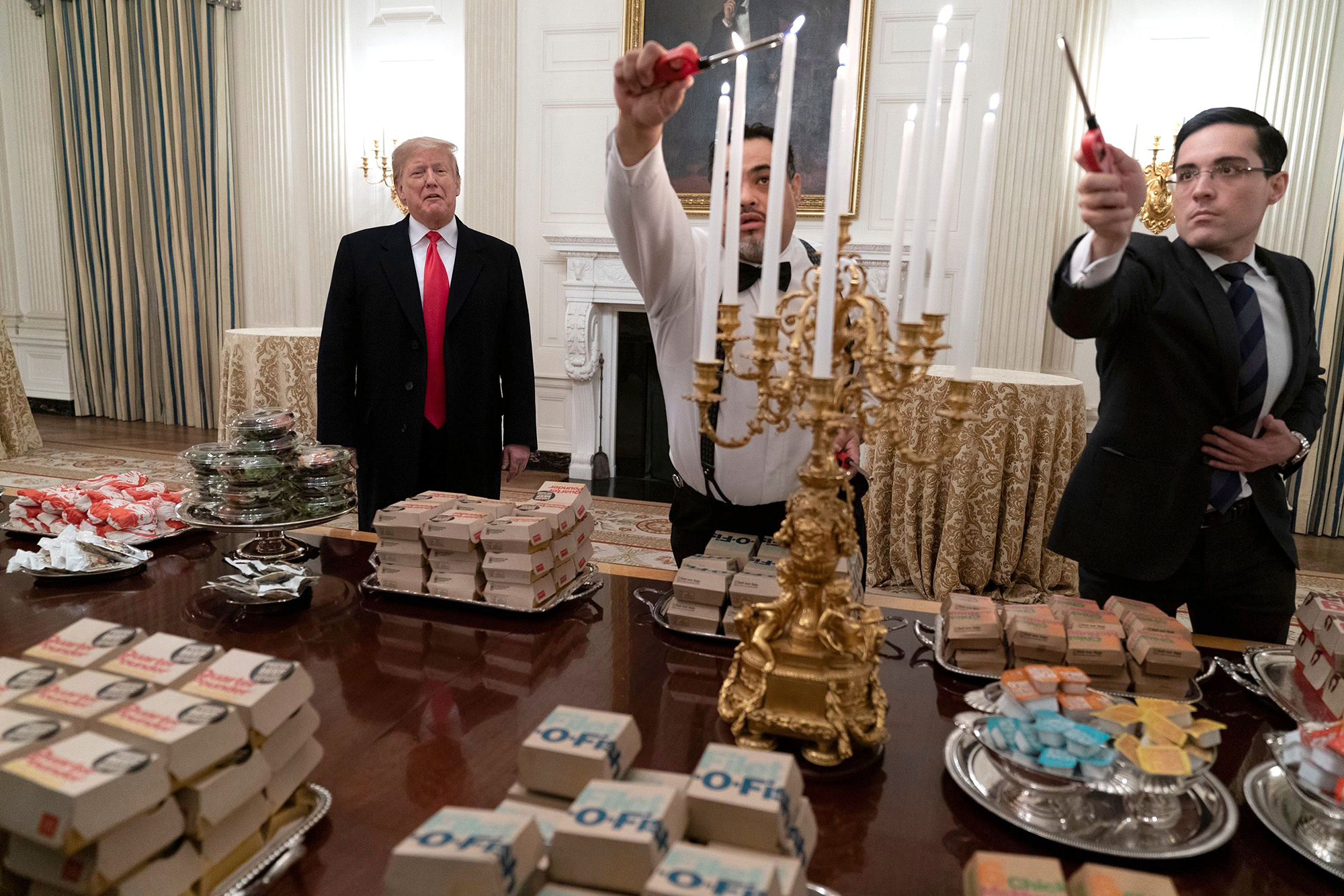 United States President Donald J. Trump presents fast food to be served to the Clemson Tigers during White House visit, Washington, USA - 14 Jan 2019