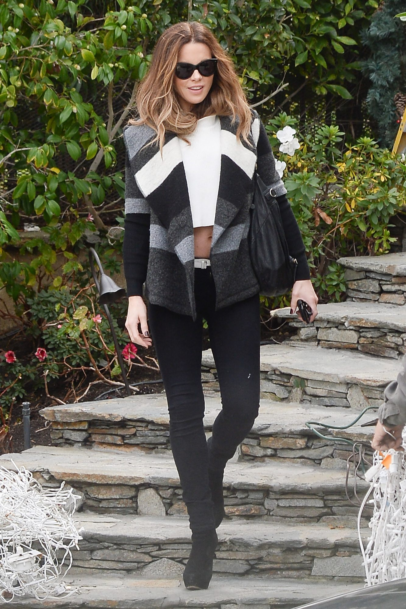 EXCLUSIVE: Kate Beckinsale Shows Off Her Toned Midsection as She Steps Out in Los Angeles.