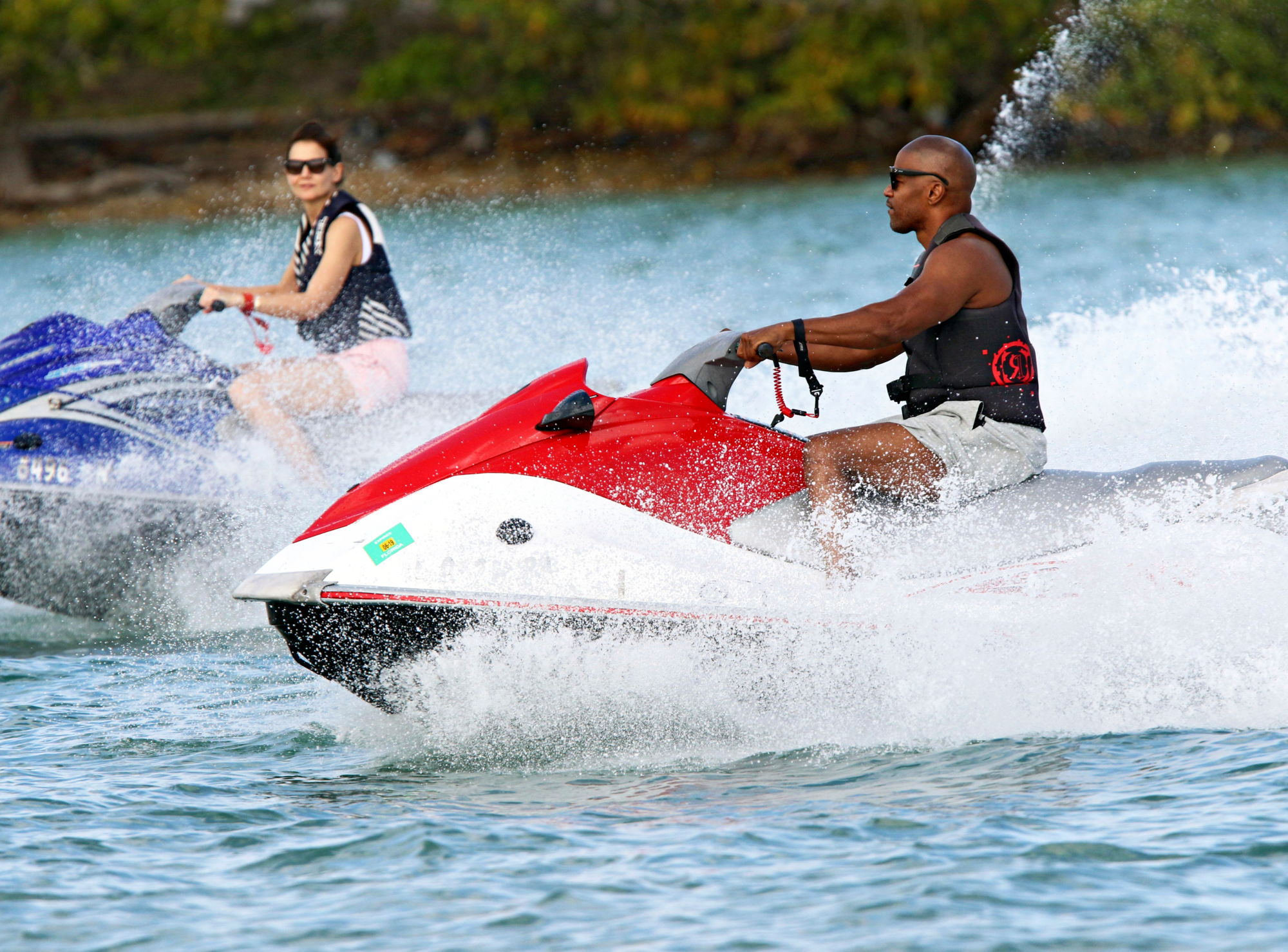*PREMIUM EXCLUSIVE* Lovebirds Katie Holmes and Jamie Foxx revved up their romantic Miami vacation with a jet ski ride over the weekend.