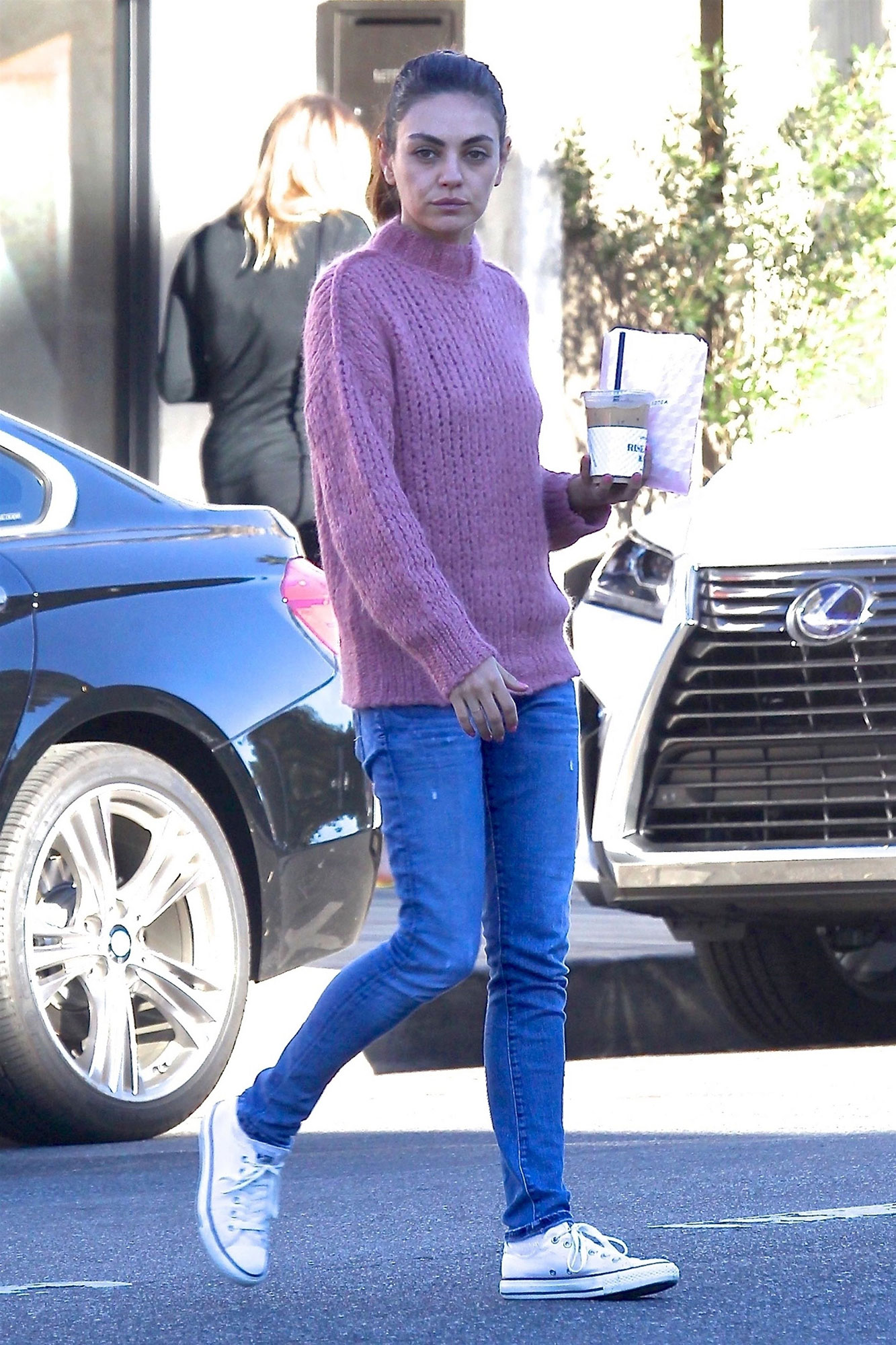 Mila Kunis sports a fuzzy pink sweater for her morning coffee run