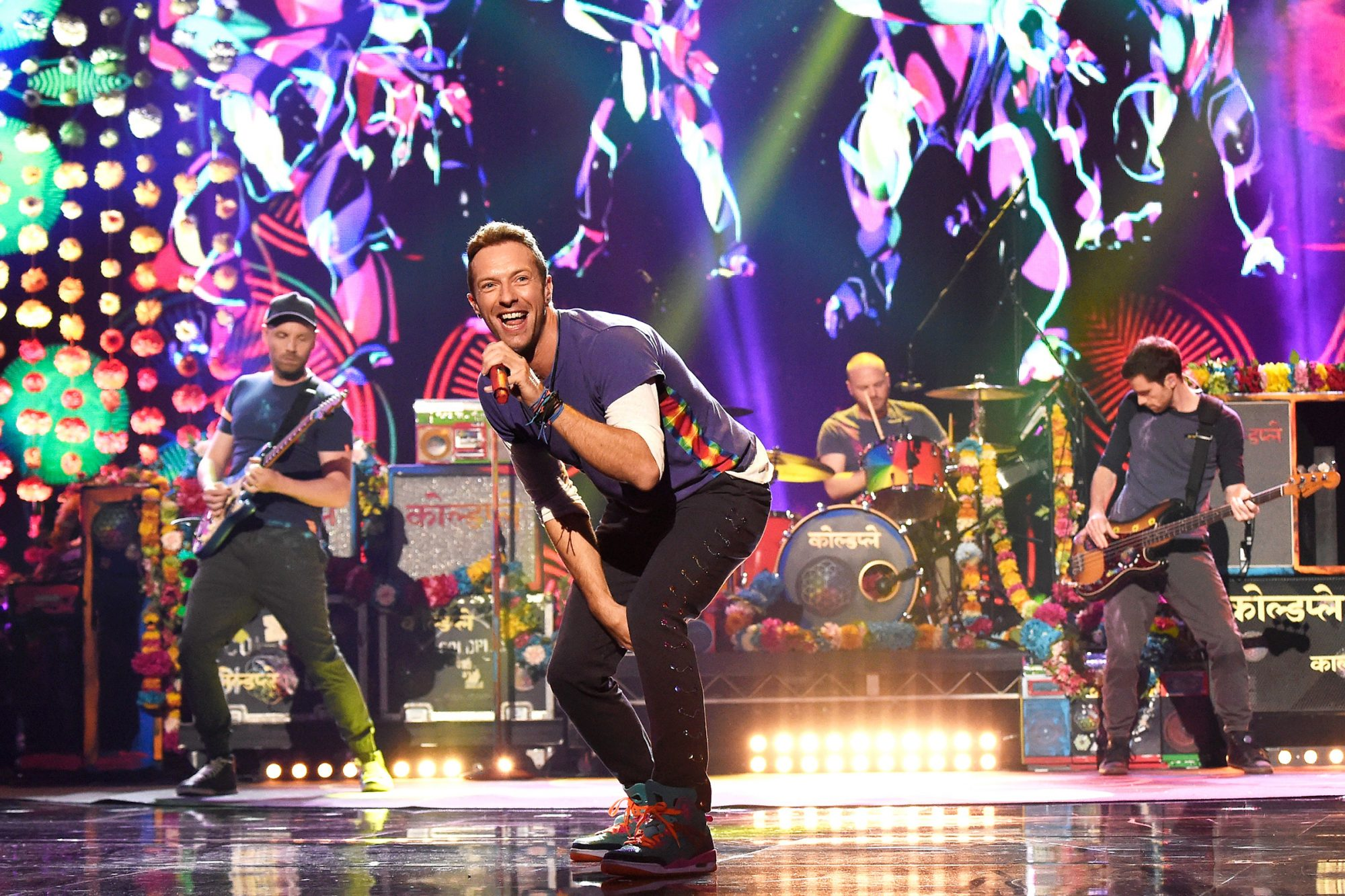Jonny Buckland, Chris Martin, Will Champion and Guy Berryman of music group Coldplay perform onstage during the 2015 American Music Awards at Microsoft Theater on November 22, 2015 in Los Angeles, California