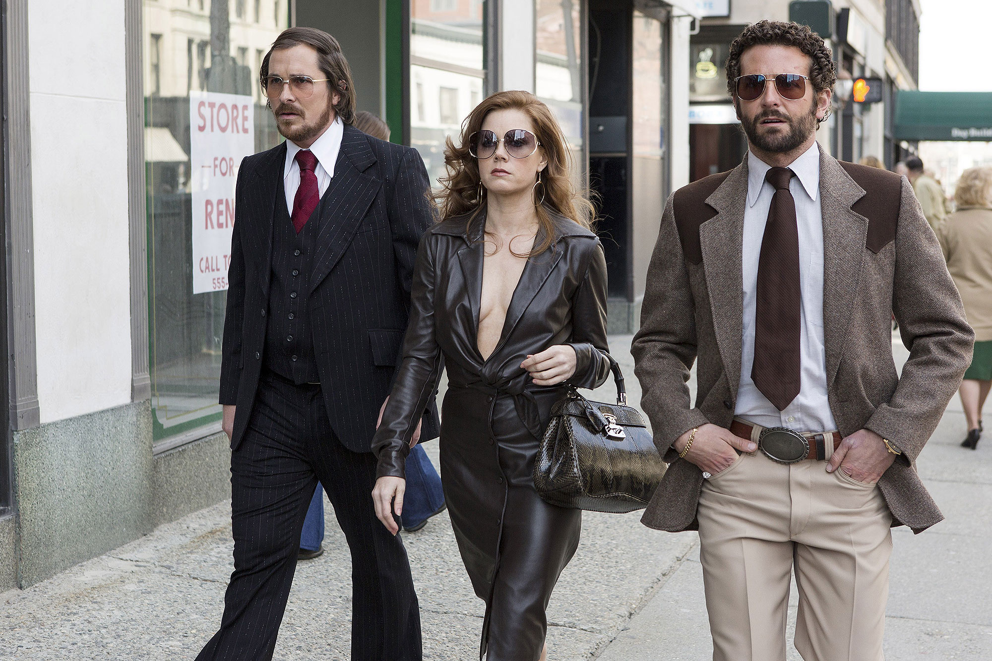 AMERICAN HUSTLE, from left: Christian Bale, Amy Adams, Bradley Cooper, 2013. ph: Francois Duhamel/©C