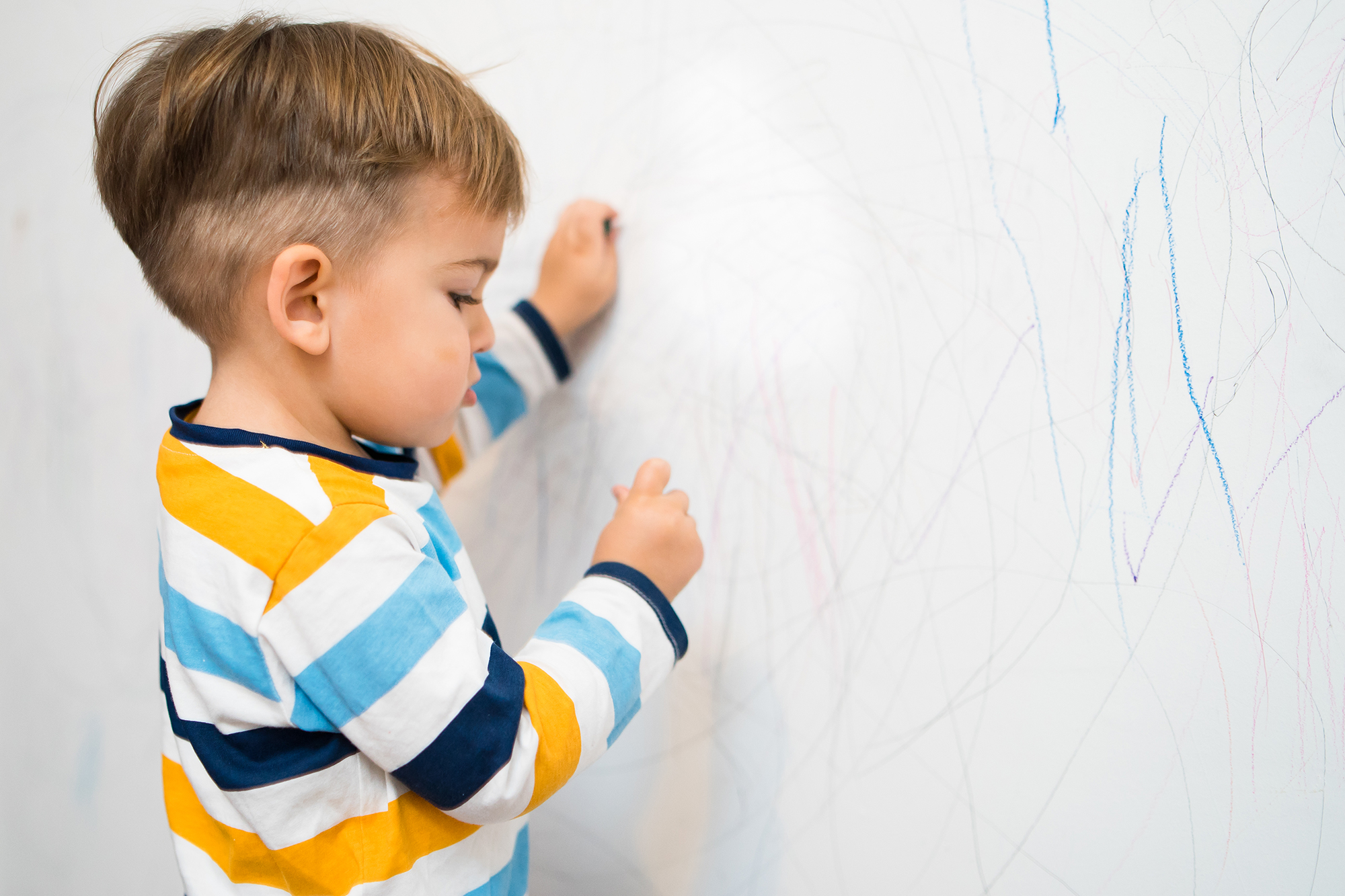 Little Boy Writing on the Wall