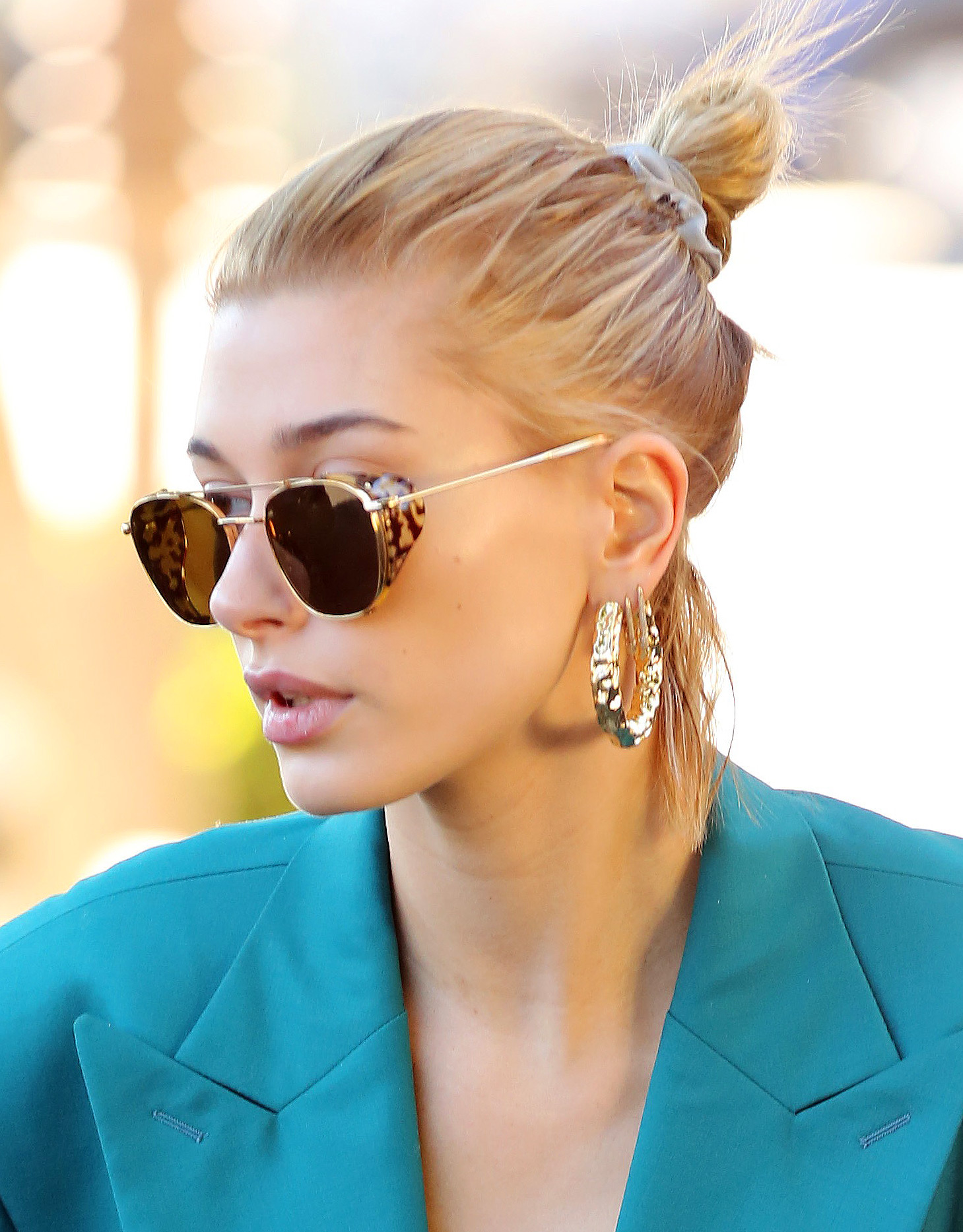 Hailey Baldwin dons a green suit to a business meeting
