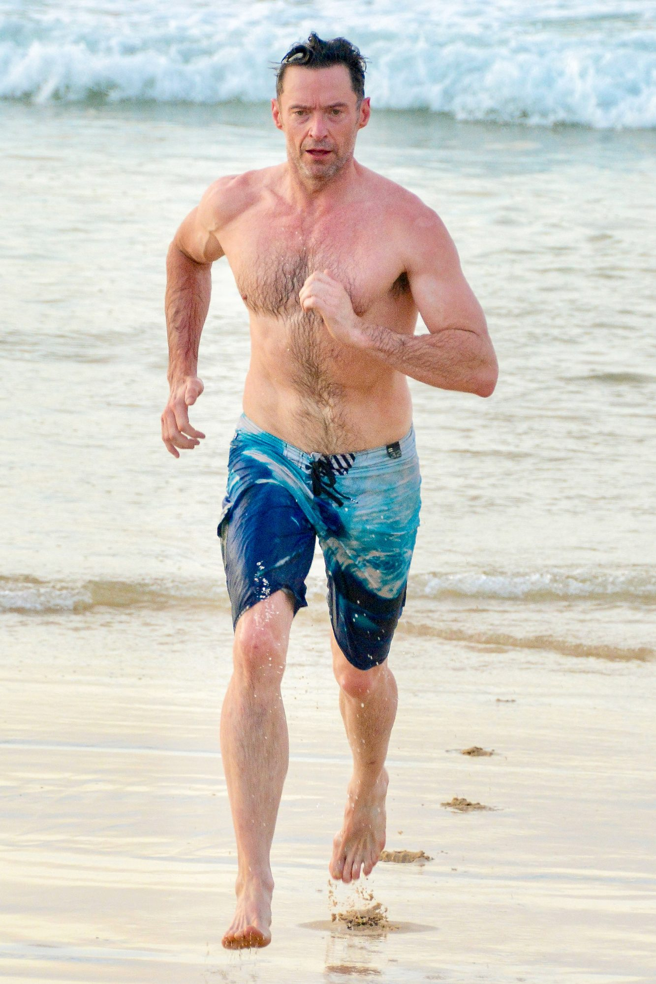 EXCLUSIVE: *NO MAIL ONLINE* Hugh Jackman Puts On His 'Greatest Show' At Bondi Beach, As He Heads Out For An Early Morning Swim