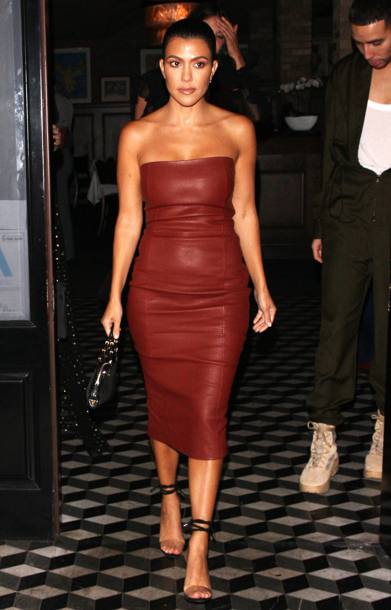 Kourtney Kardashian wears a maroon red leather dress as she is seen leaving Catch LA, then heading over to Craig's Restaurant with her friends
