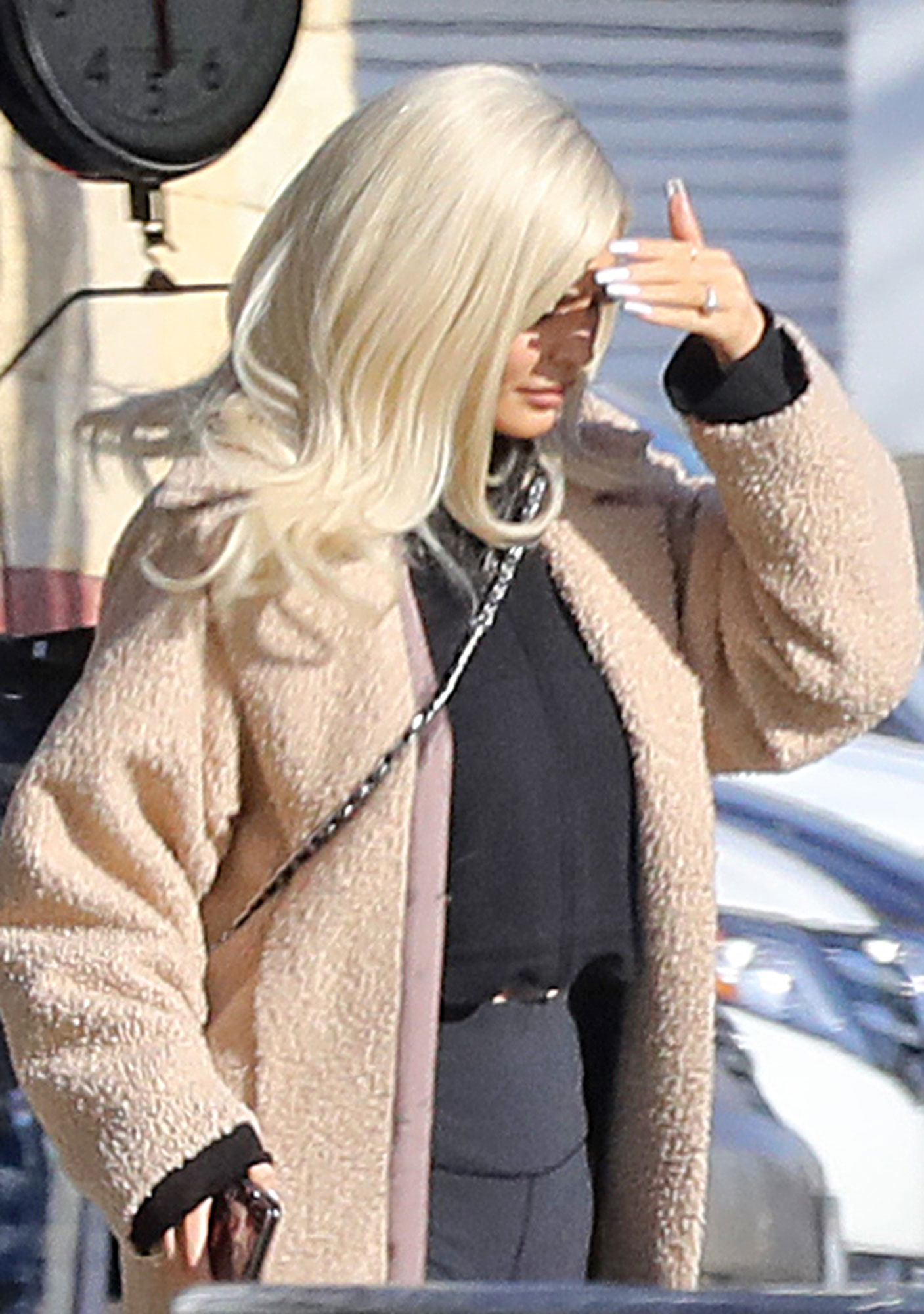 Kylie Jenner continues to fuel rumors she's engaged to Travis Scott as she steps out with a diamond ring on her wedding finger.