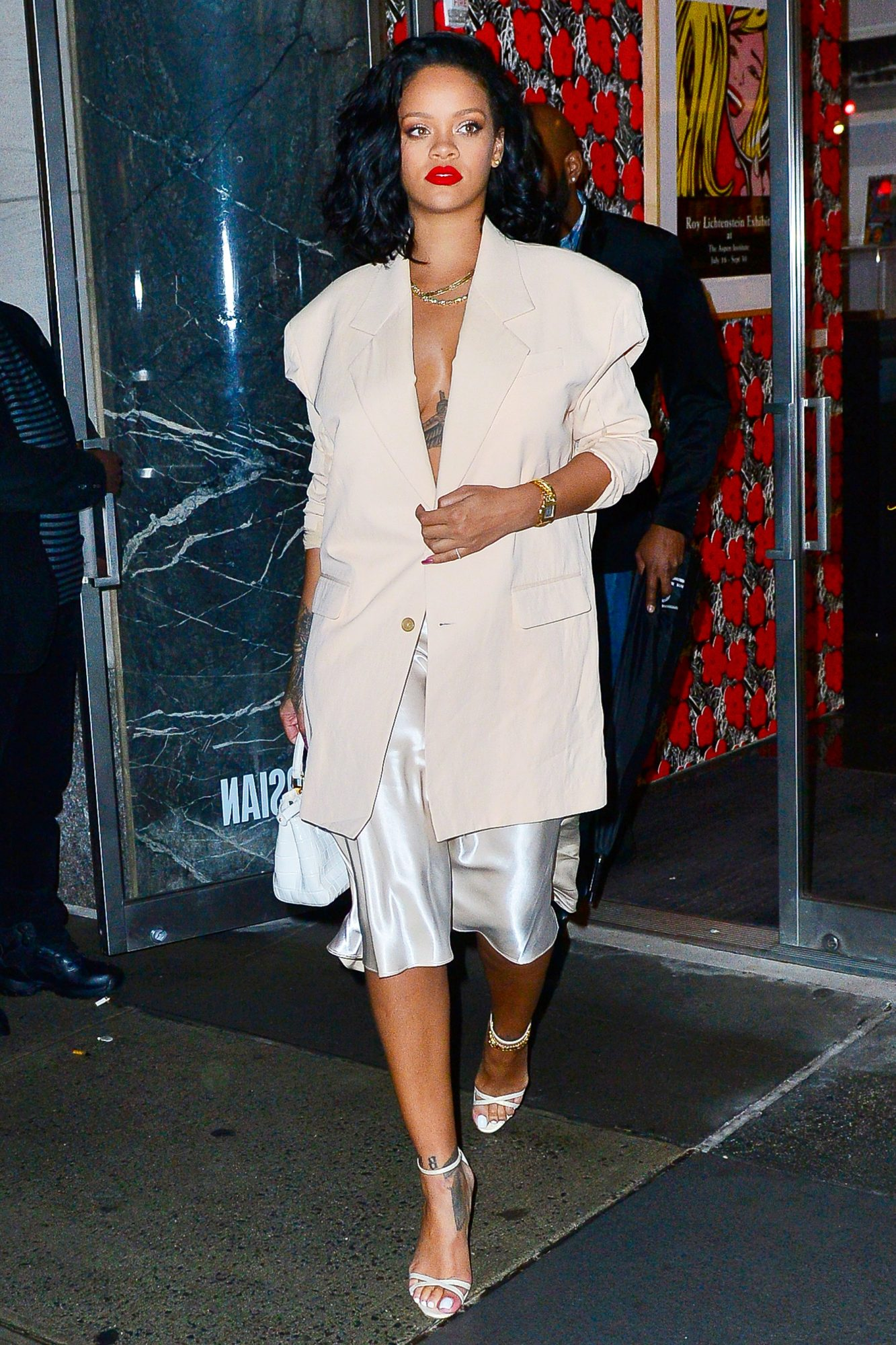 Rihanna looks striking as she  leaves dinner in NYC in silver gown under jacket