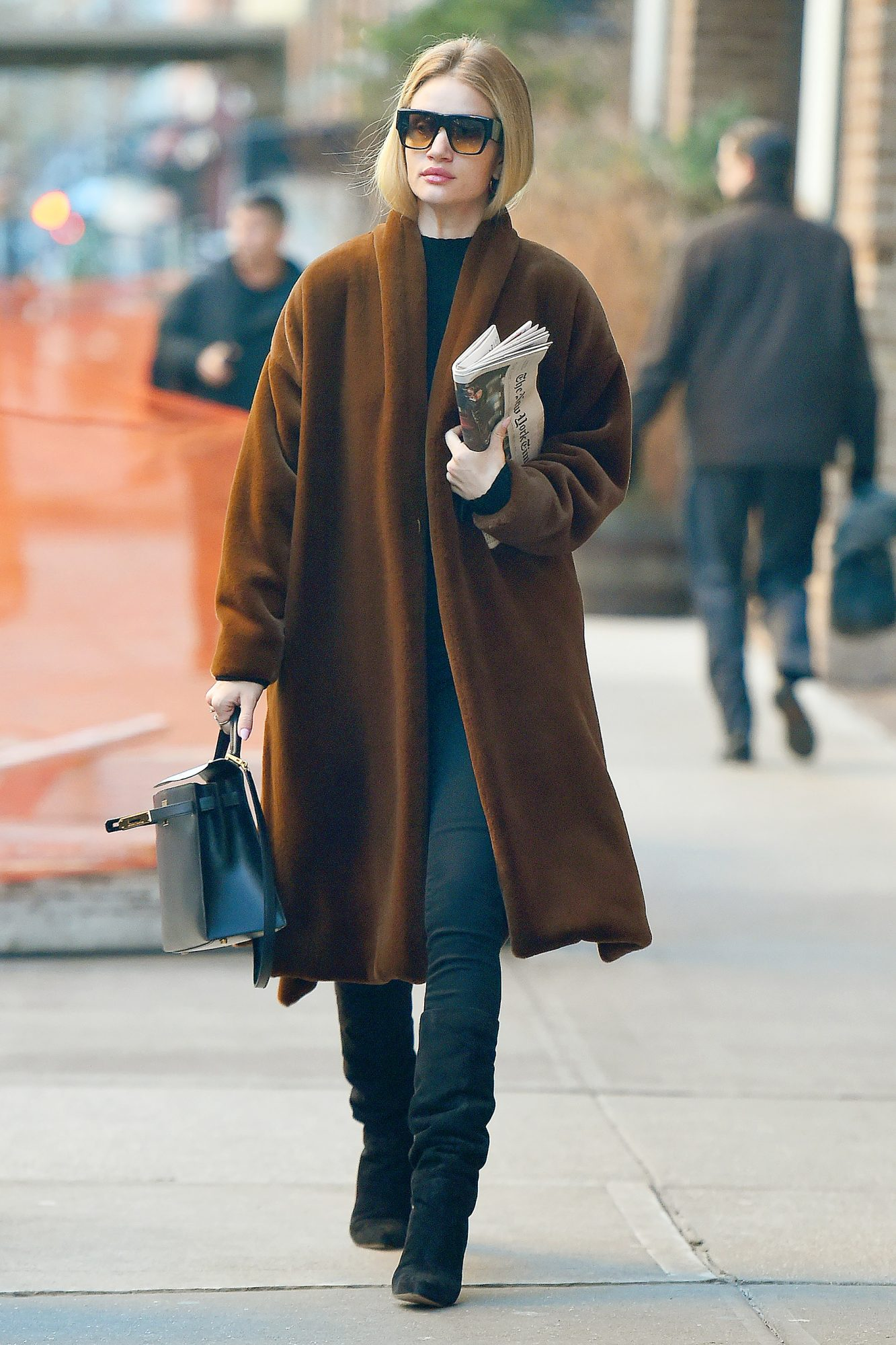 Rosie Huntington-Whiteley Carries The New York Times Newspaper In New York City