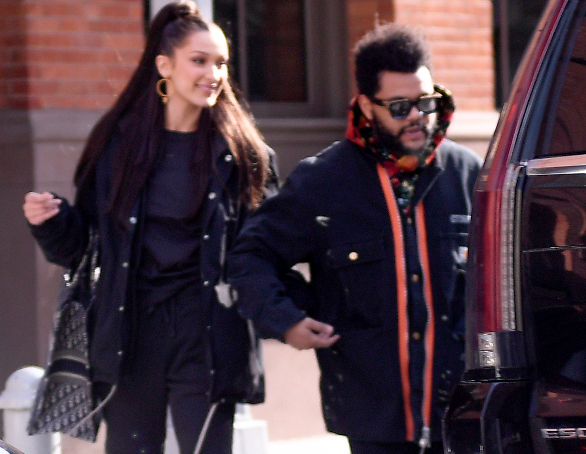 The Weeknd and his girlfriend Bella Hadid are photographed holding hands while leaivng their New York City apartment this morning