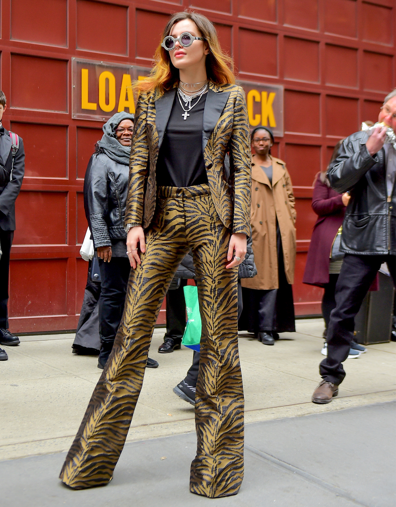 Bella Thorne Wows in Prabal Gurung Tiger Print Pantsuit as she Arrives with Boyfriend Modsun to Carnegie Hall