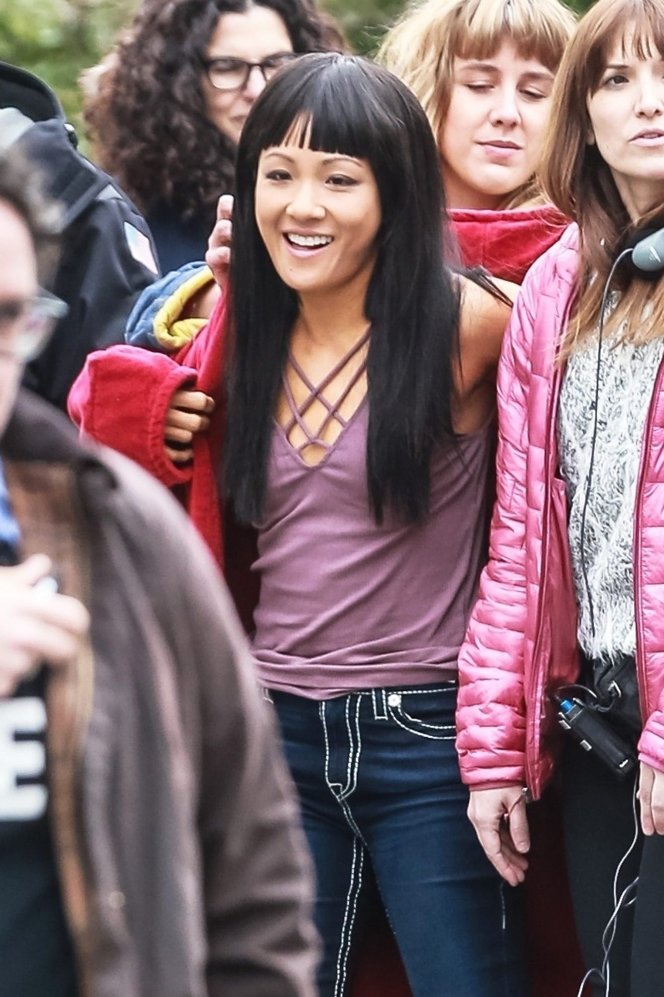 """Constance Wu wears a red robe on the set of """"The Hustlers"""""""