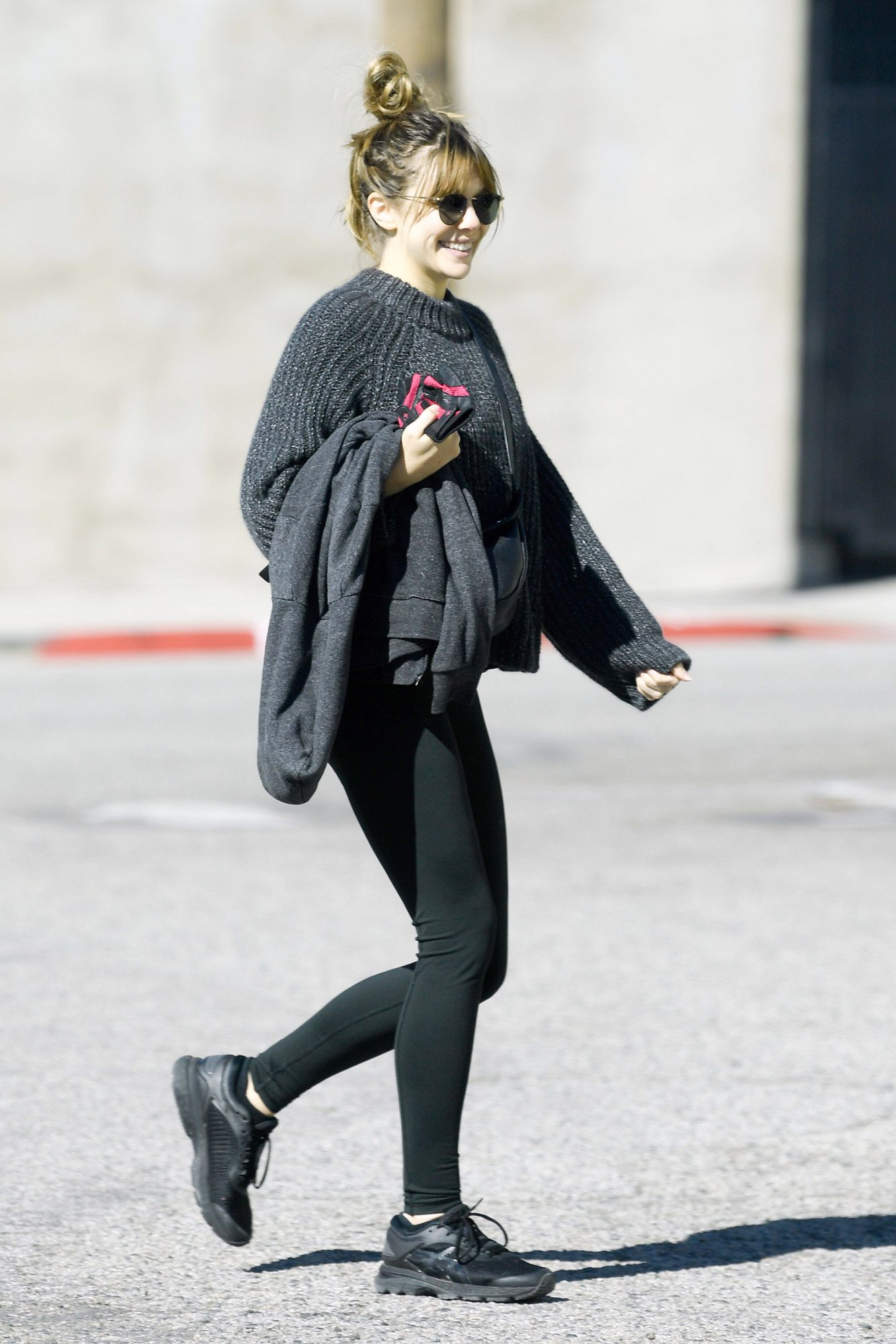 EXCLUSIVE: Elizabeth Olsen is All Smiles as She Heads to a Gym in Los Angeles.