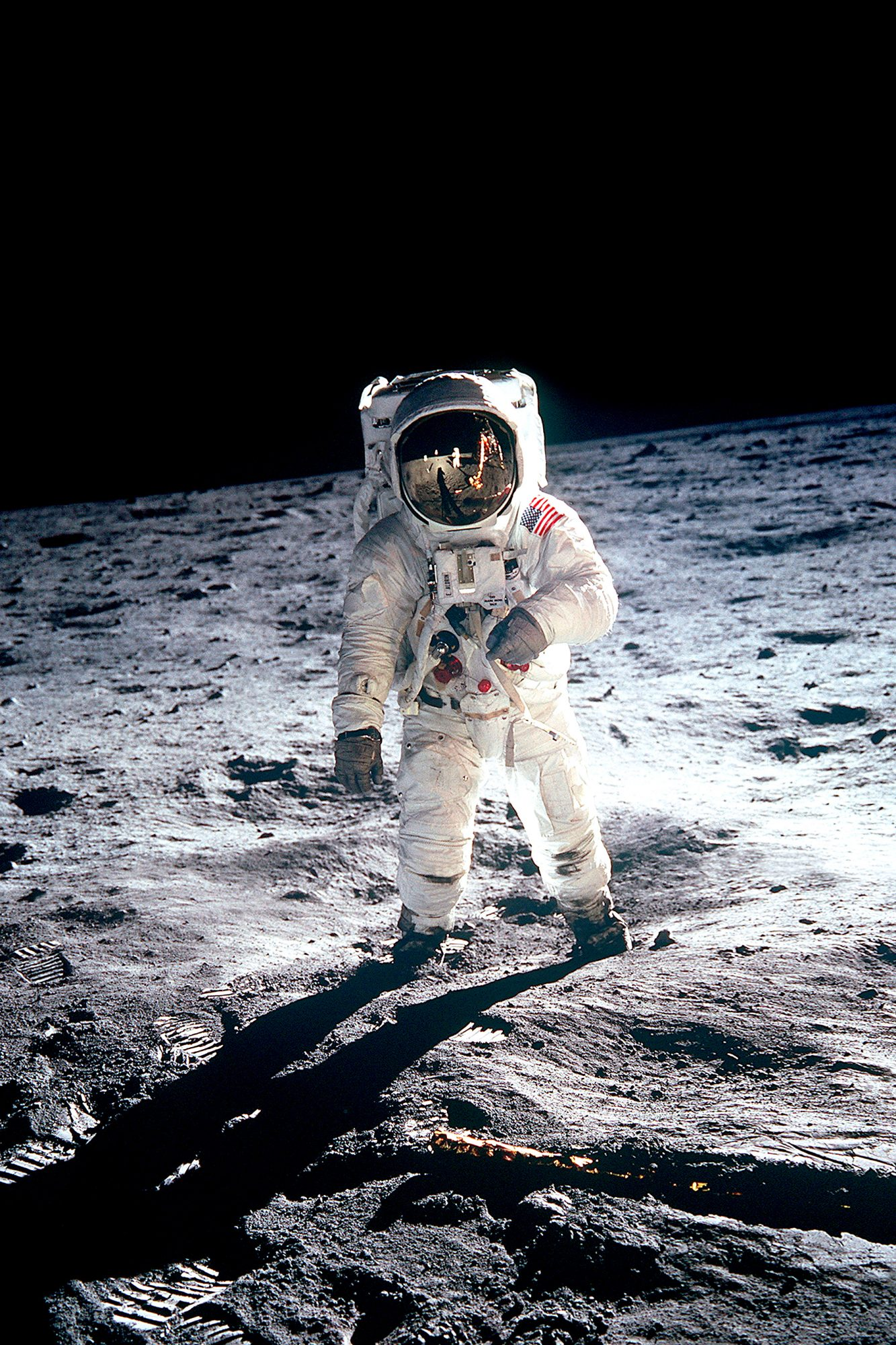 Photograph of Edwin Aldrin taken during the Apollo 11 mission. Neil Armstong reflected in the visor.