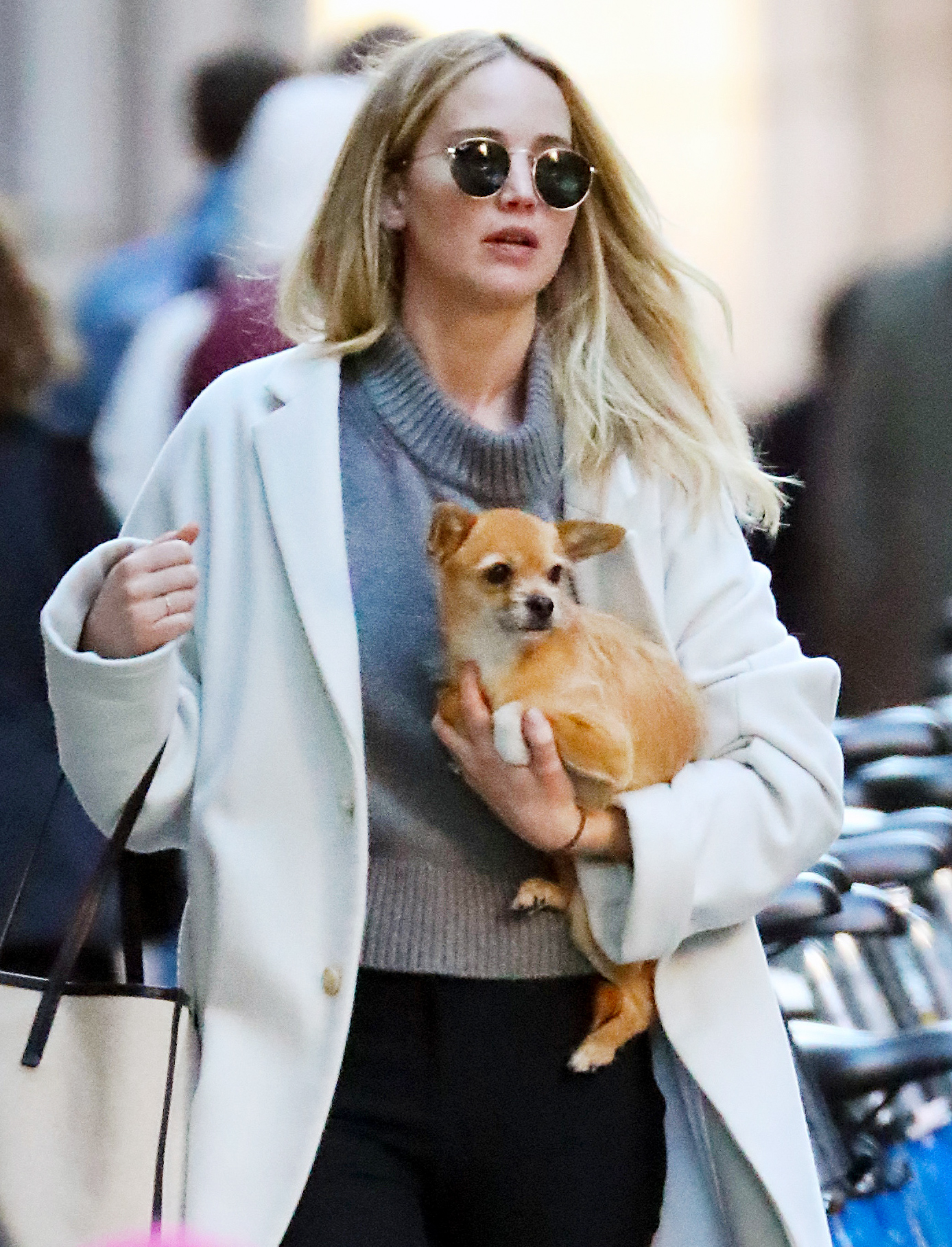 EXCLUSIVE: Jennifer Lawrence Cradles Her Dog Pippi while Out and About in New York City