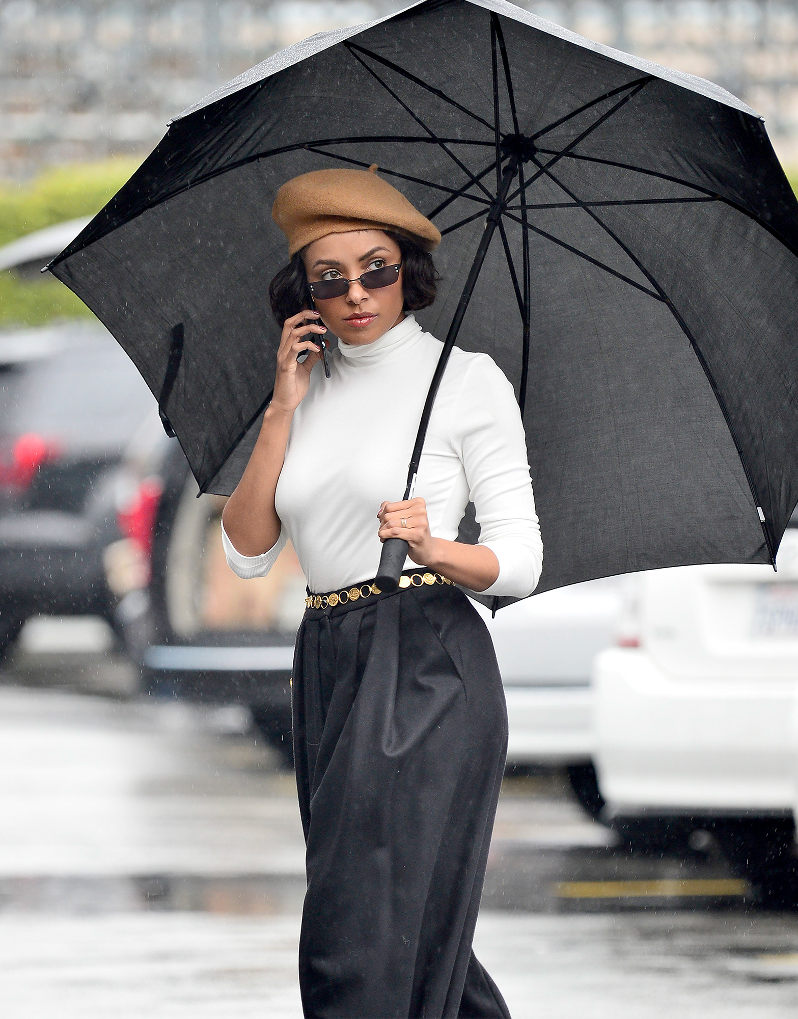 EXCLUSIVE: Kat Graham gets caught in the rain whilst on a photoshoot