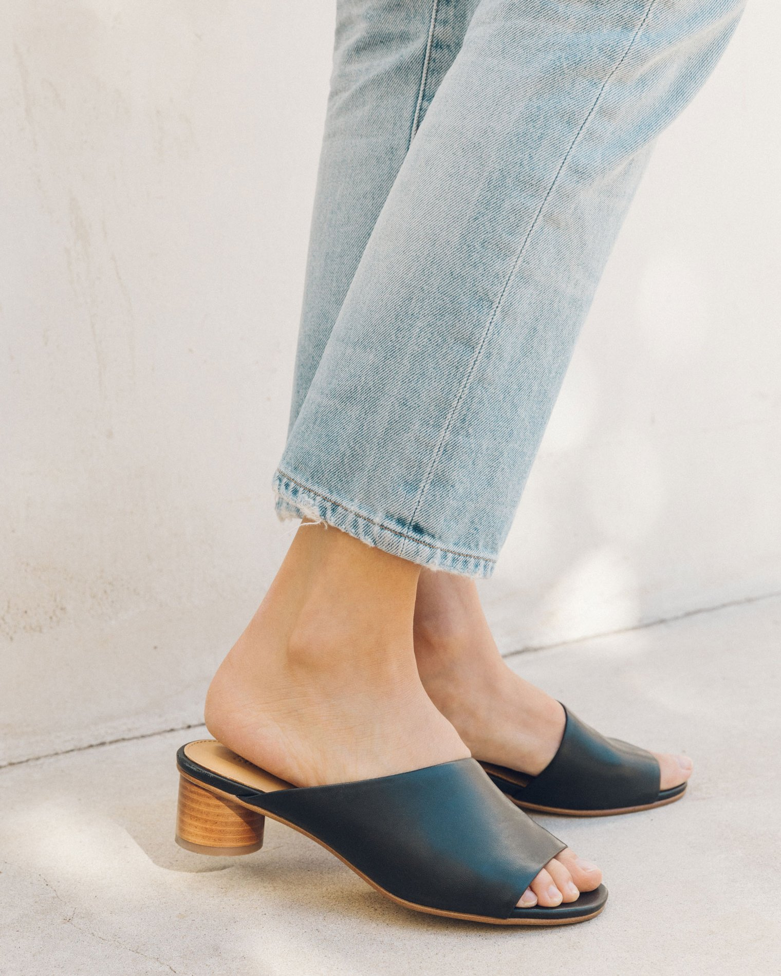 Black leather mule with wooden heel from Soludos