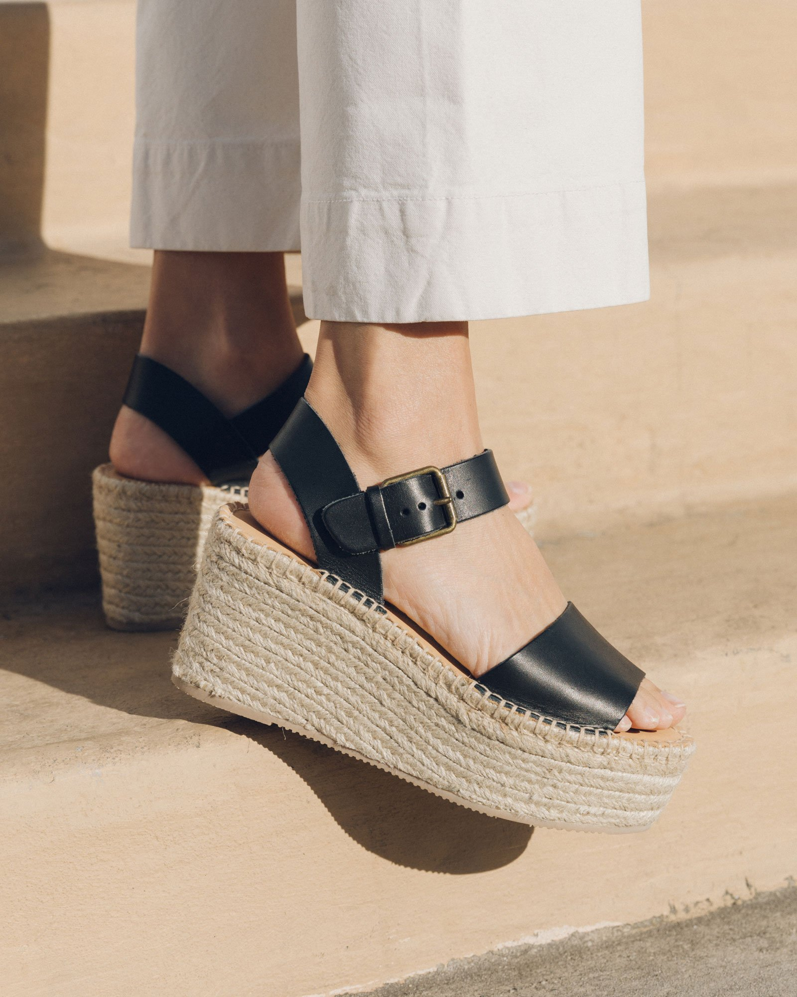 Black leather open-toe espadrille wedges from Soludos