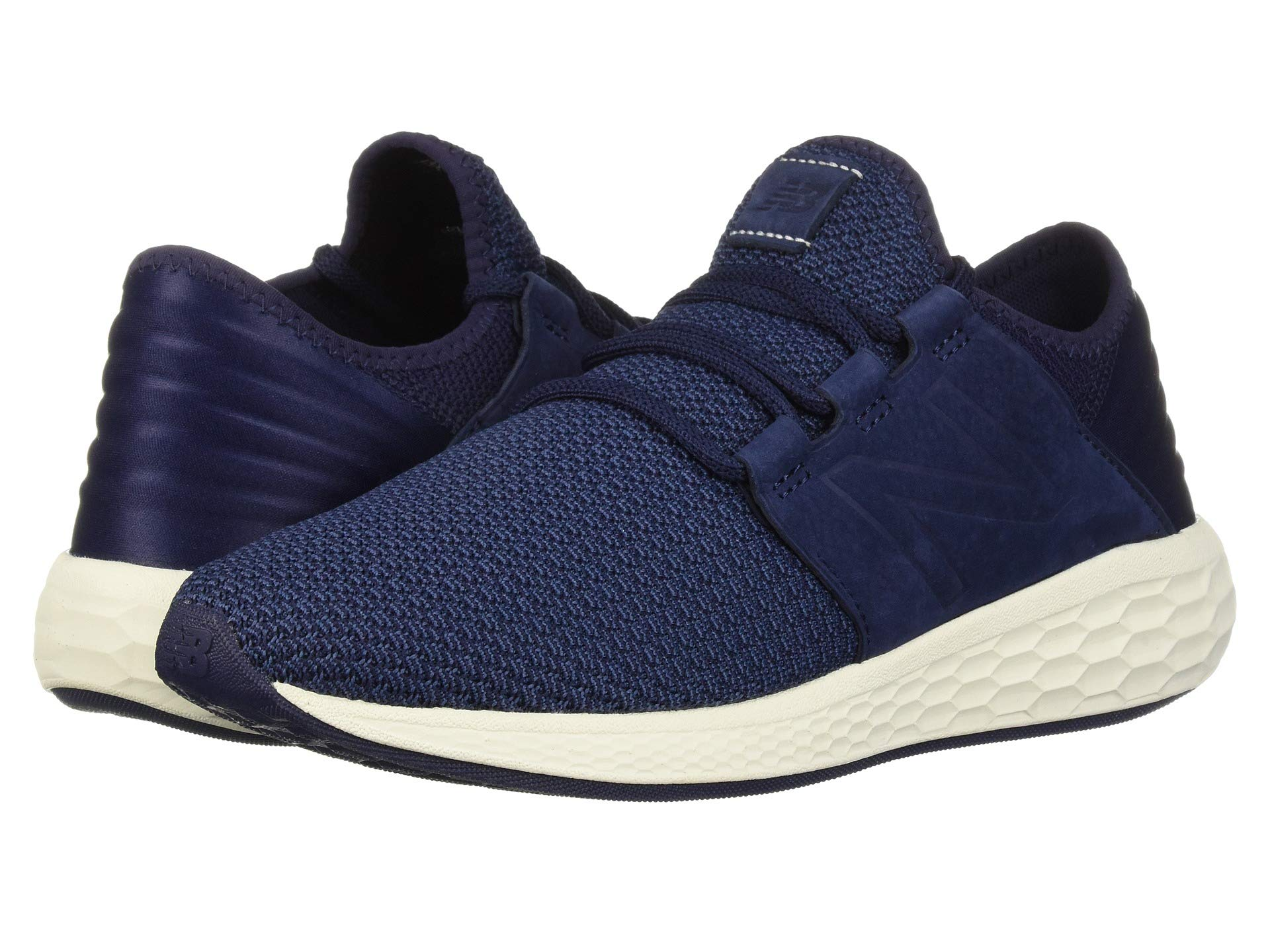 Navy blue lightweight New Balance sneakers at Zappos