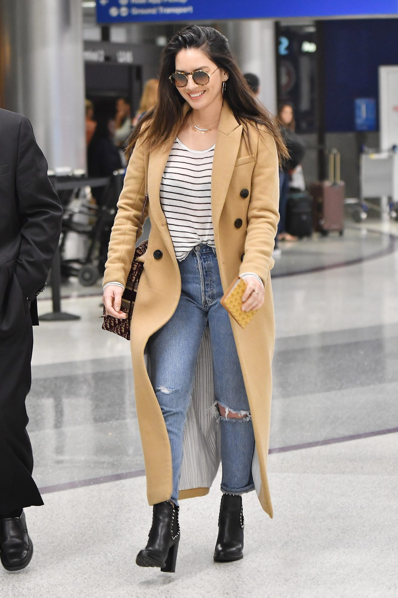 Olivia Munn is Pictured at LAX Airport in Los Angeles.