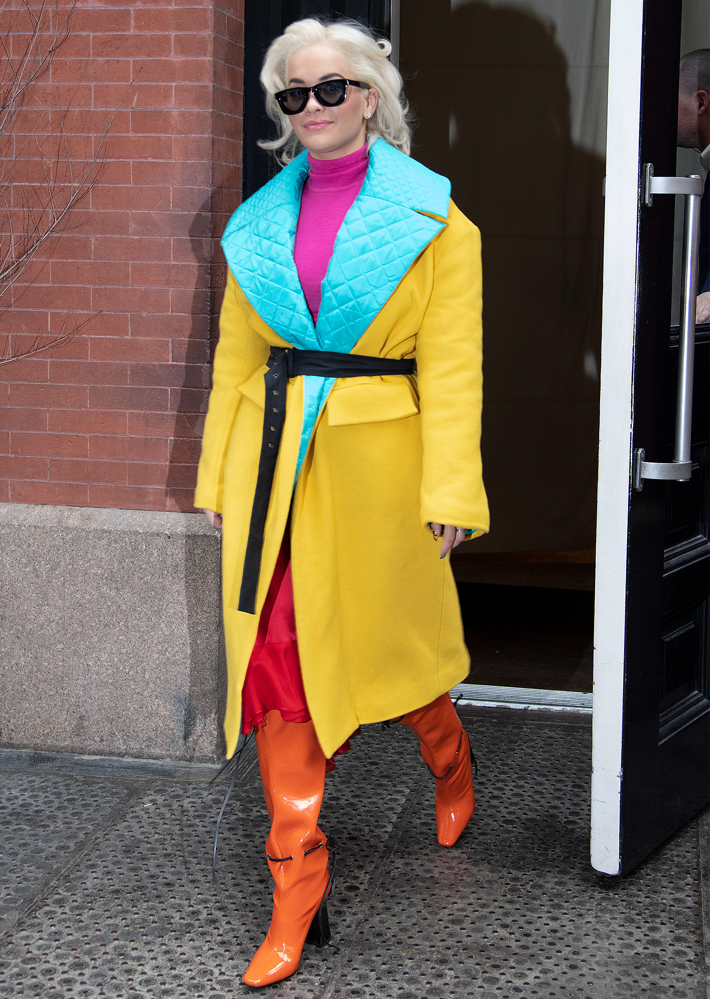 Rita Ora puts on a colorful display as she steps out to the spa in Tribeca, New York.