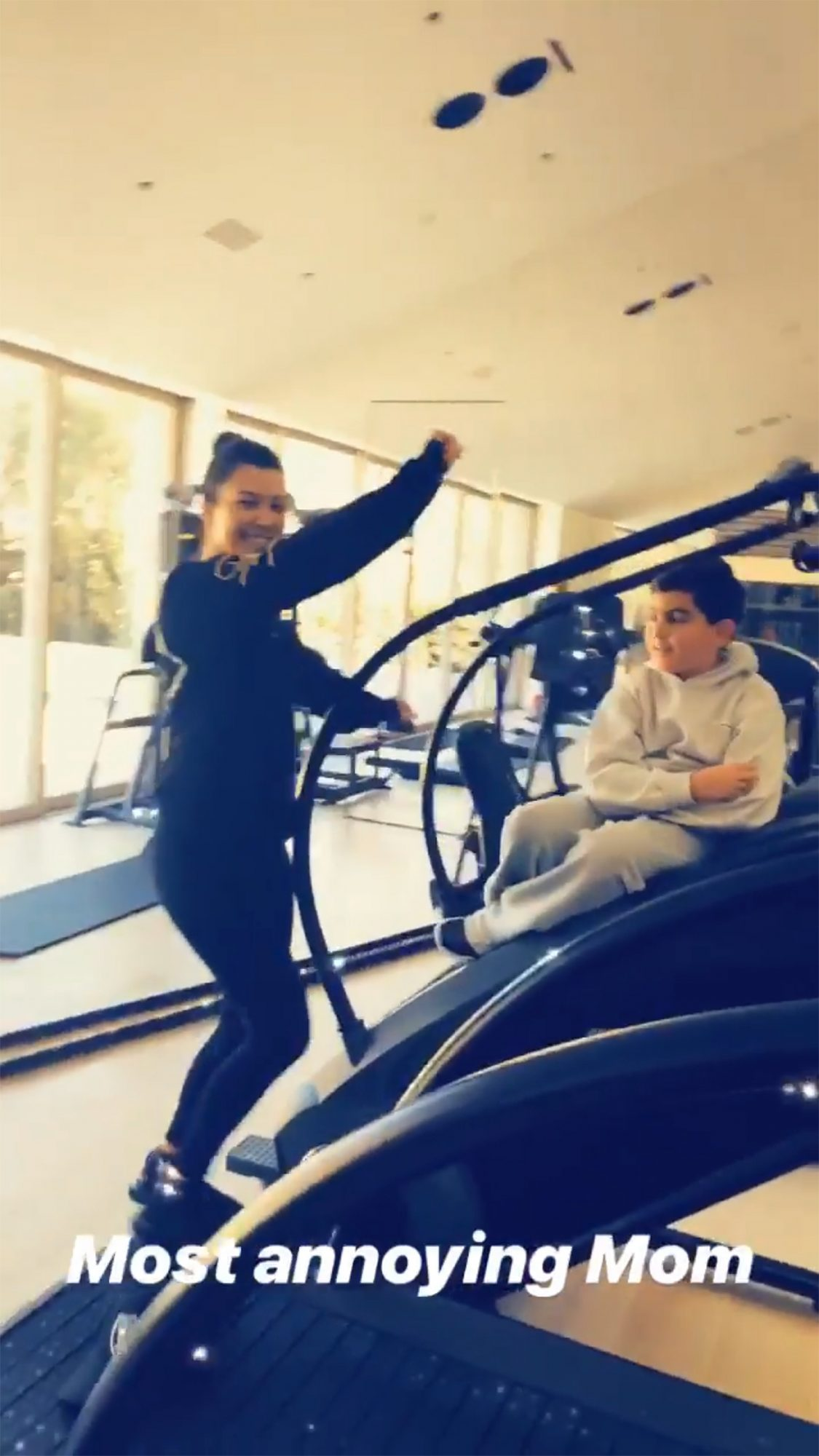 """When you're 9, you love your mom but she can sometimes be... embarrassing. That's how Mason felt when Kardashian started dancing to Tyga's song """"Taste"""" on a StairMaster as he sat nearby.                             Aunt Khloé, who was capturing the whole """"annoying"""" situation on Instagram stories, yelled, """"Mason, moms dance too!"""" while laughing as Mason eventually bolted from his spot and ran out of the room."""