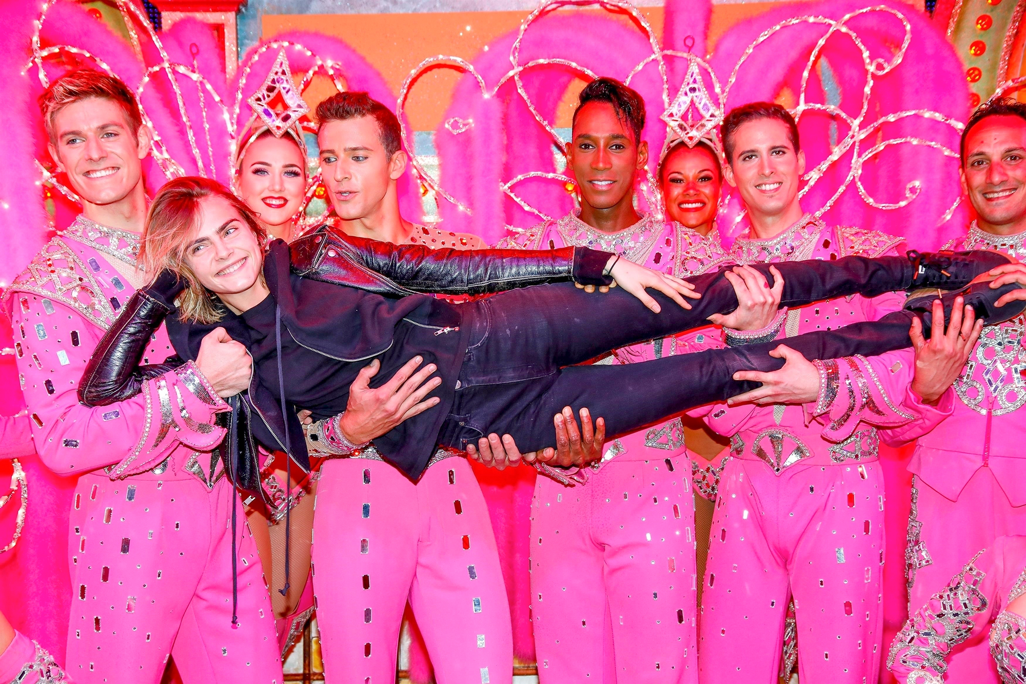 *EXCLUSIVE* Cara Delevingne poses with the Moulin Rouge dancers