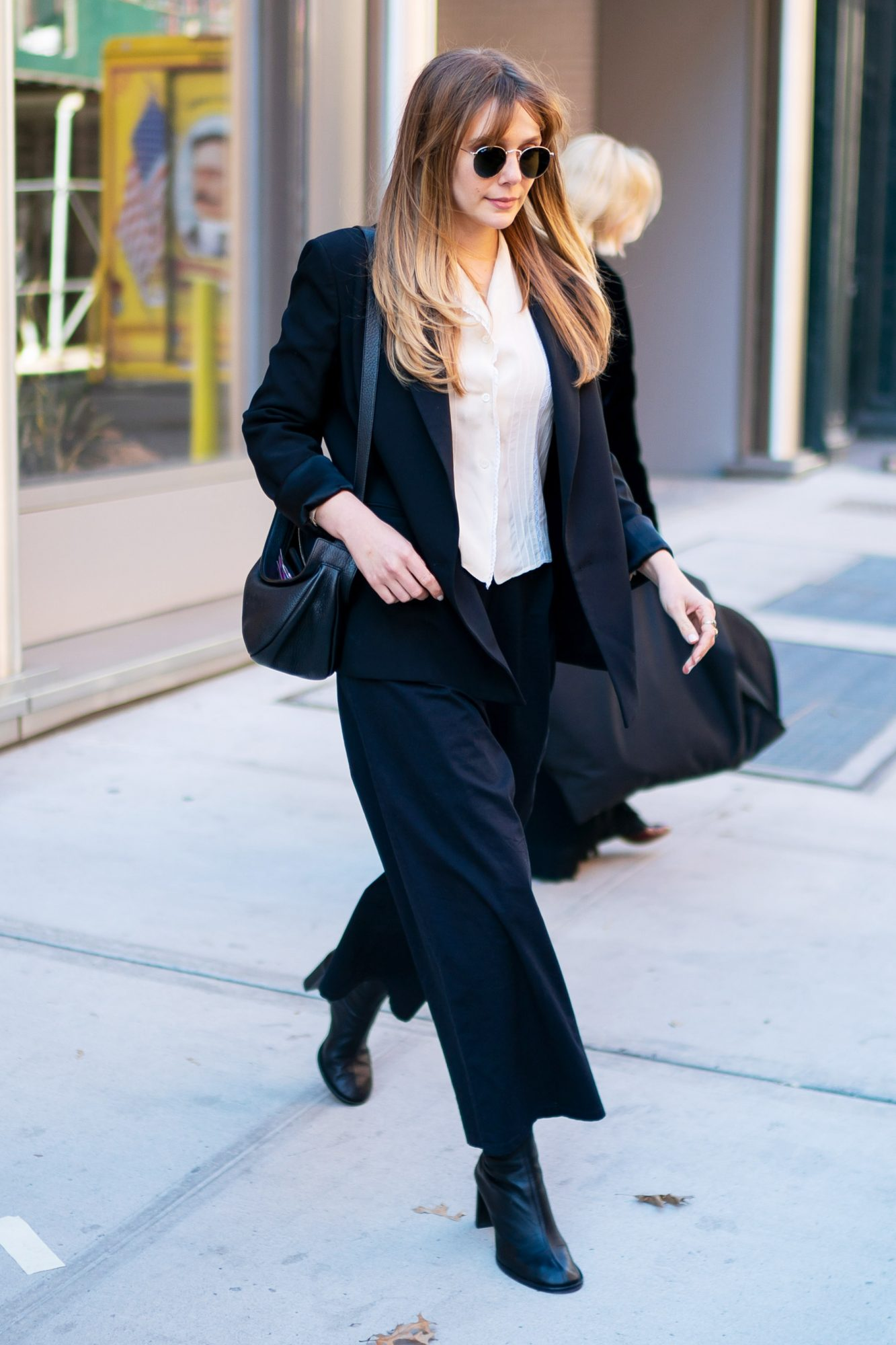 EXCLUSIVE: Elizabeth Olsen Leaves #ConfidentBeauty By Bobbi Brown Lunch In New York City